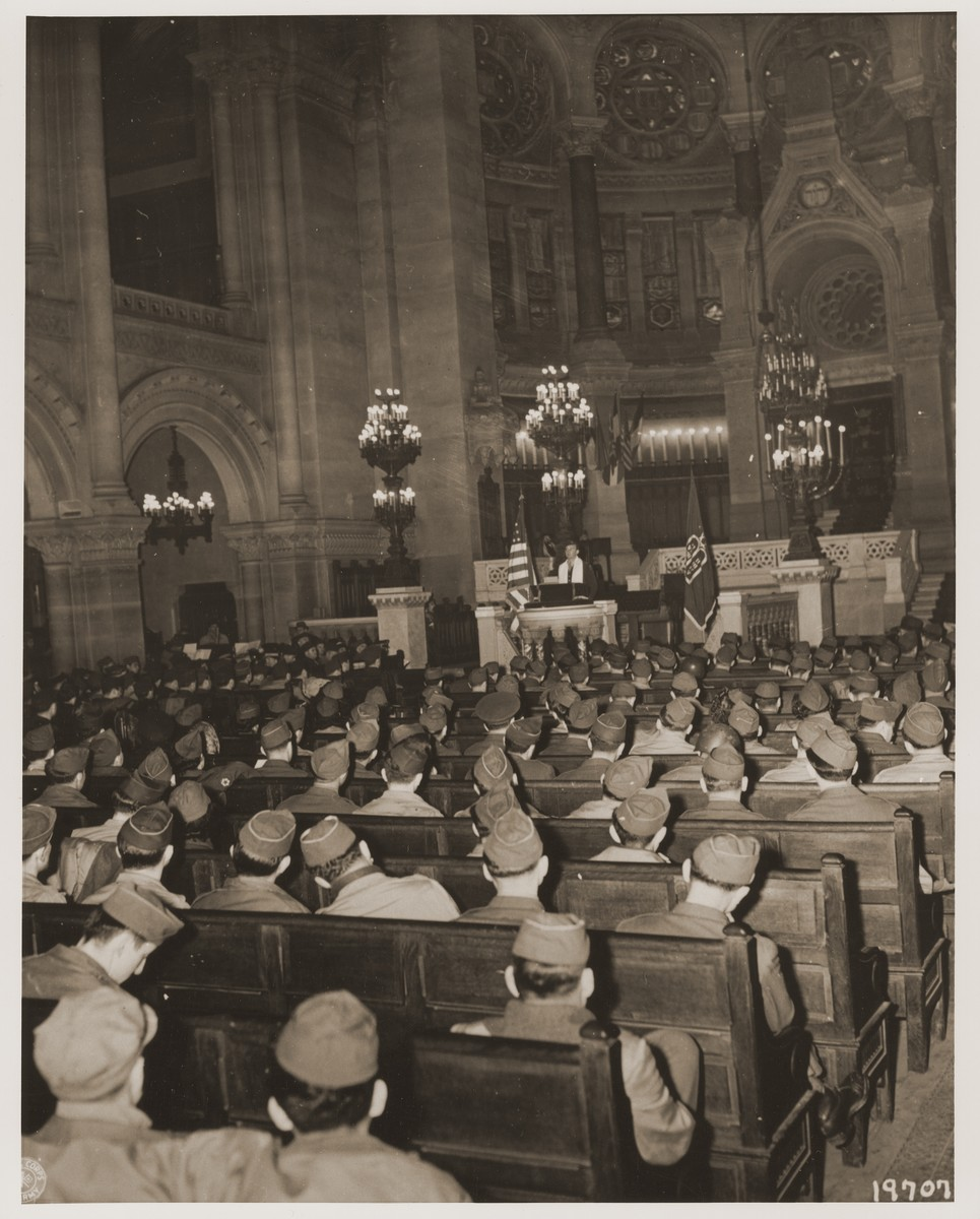Chaplain Judah Nadich delivers a sermon to American servicemen at a Thanksgiving service in the rue de la Victoire synagogue in Paris.