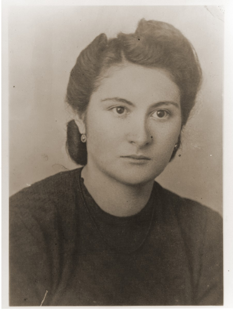 Identity card photo of a young Jewish woman in Bielsko Biala, Poland.    Pictured is eighteen-year-old Amalie Reichmann.