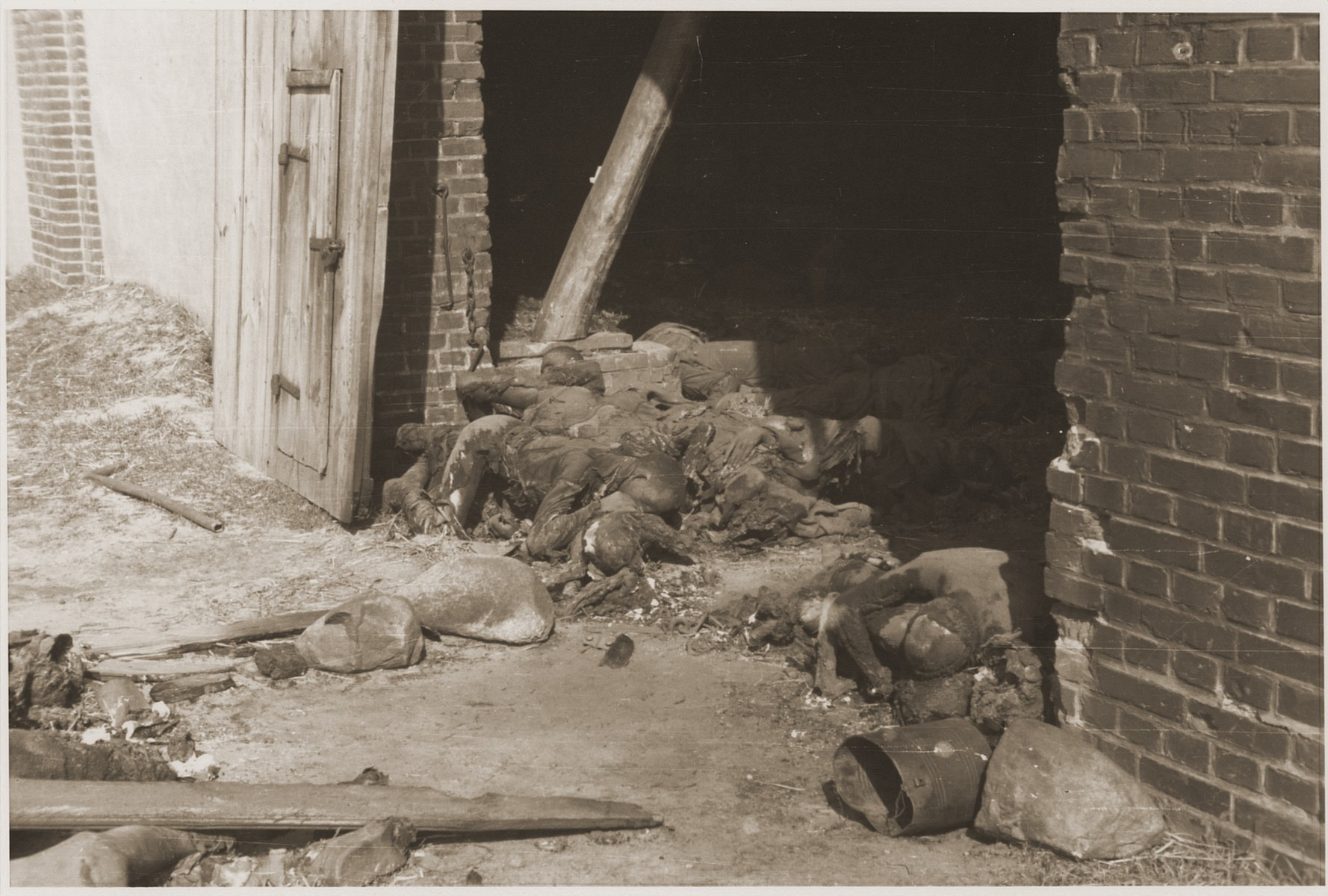Bodies piled up just inside the entrance to a barn near Gardelegen where over 1,000 prisoners were burned alive by the SS.