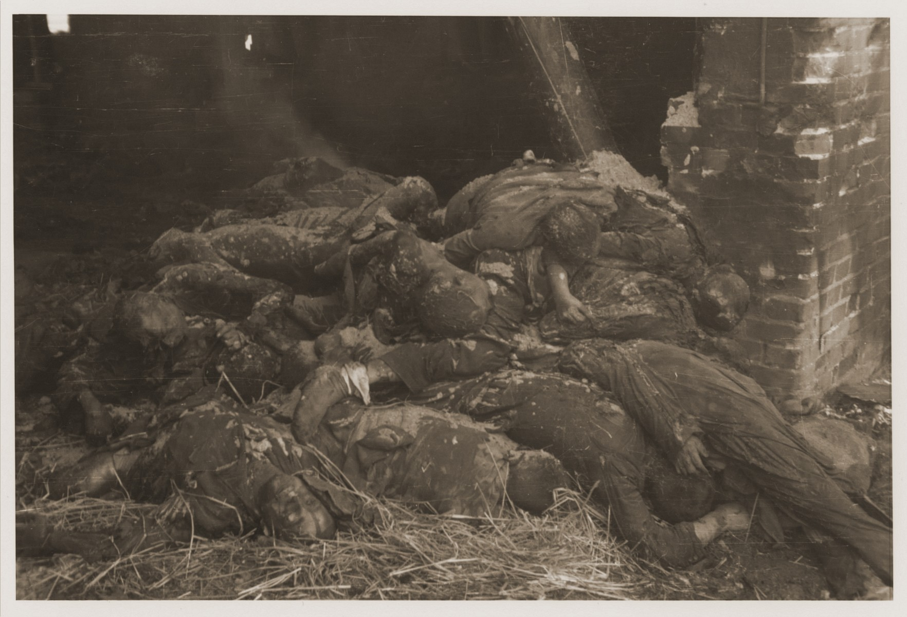 The charred corpses of prisoners burned alive by the SS in a barn outside Gardelegen lie piled just inside a doorway.