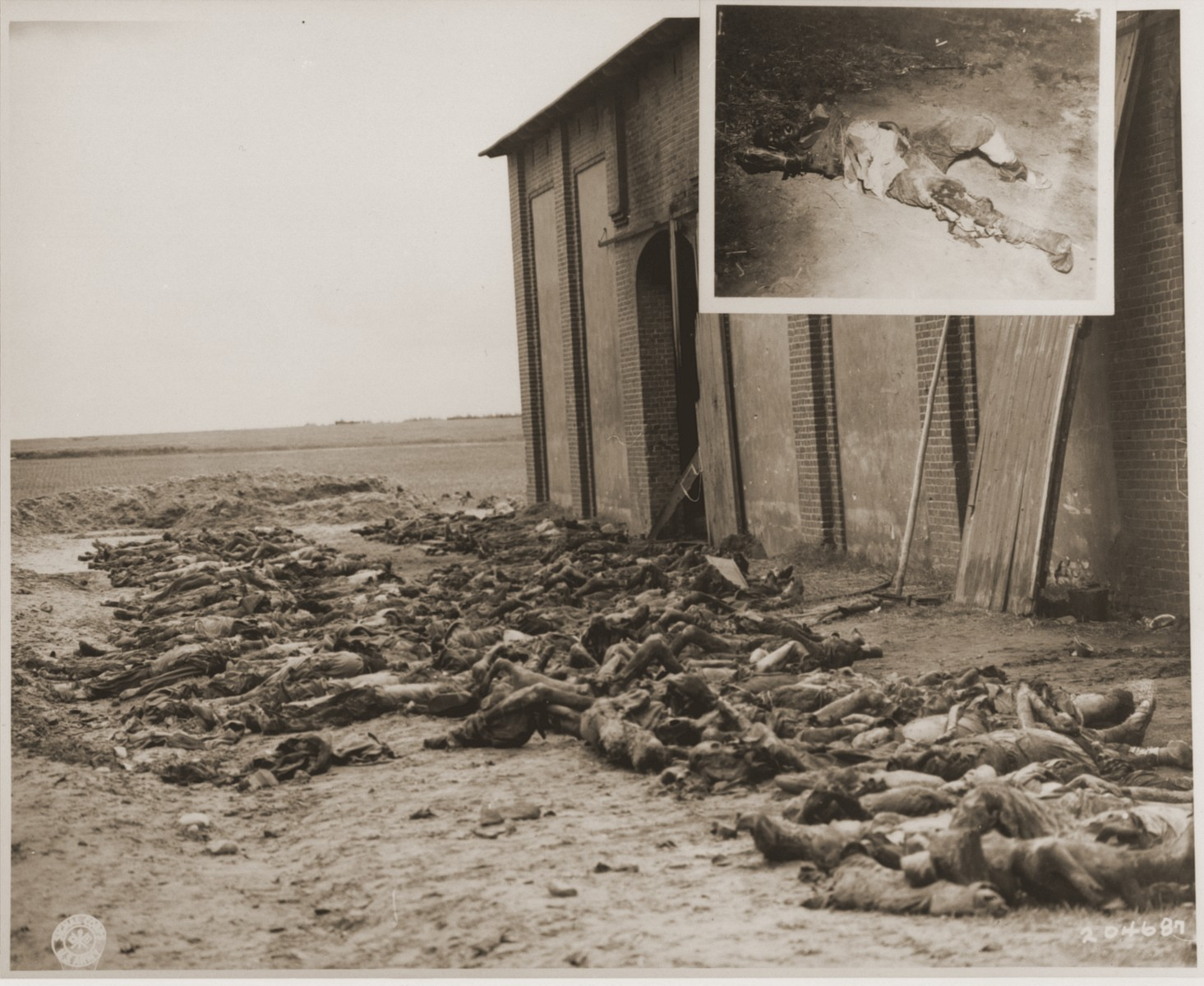 The bodies of concentration camp prisoners killed by the SS lie outside of a barn near Gardelegen where they were placed by German civilian forced by the U.S. Army to clear the site.