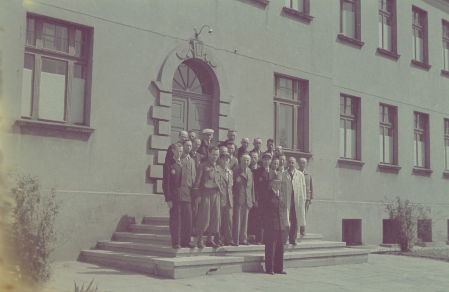 "Group portrait of the Jewish management of the saddle-making workshop in the Lodz ghetto.  Original caption: ""Litzmannstadt-getto, Leitung der Sattlerei"" (management of the saddlery)."