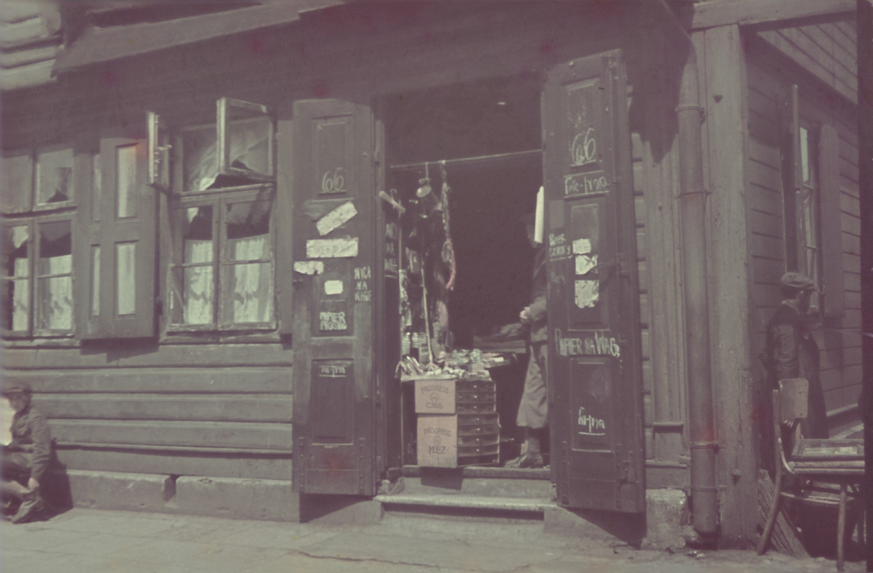 View of a store in the Lodz ghetto as seen through an open doorway.