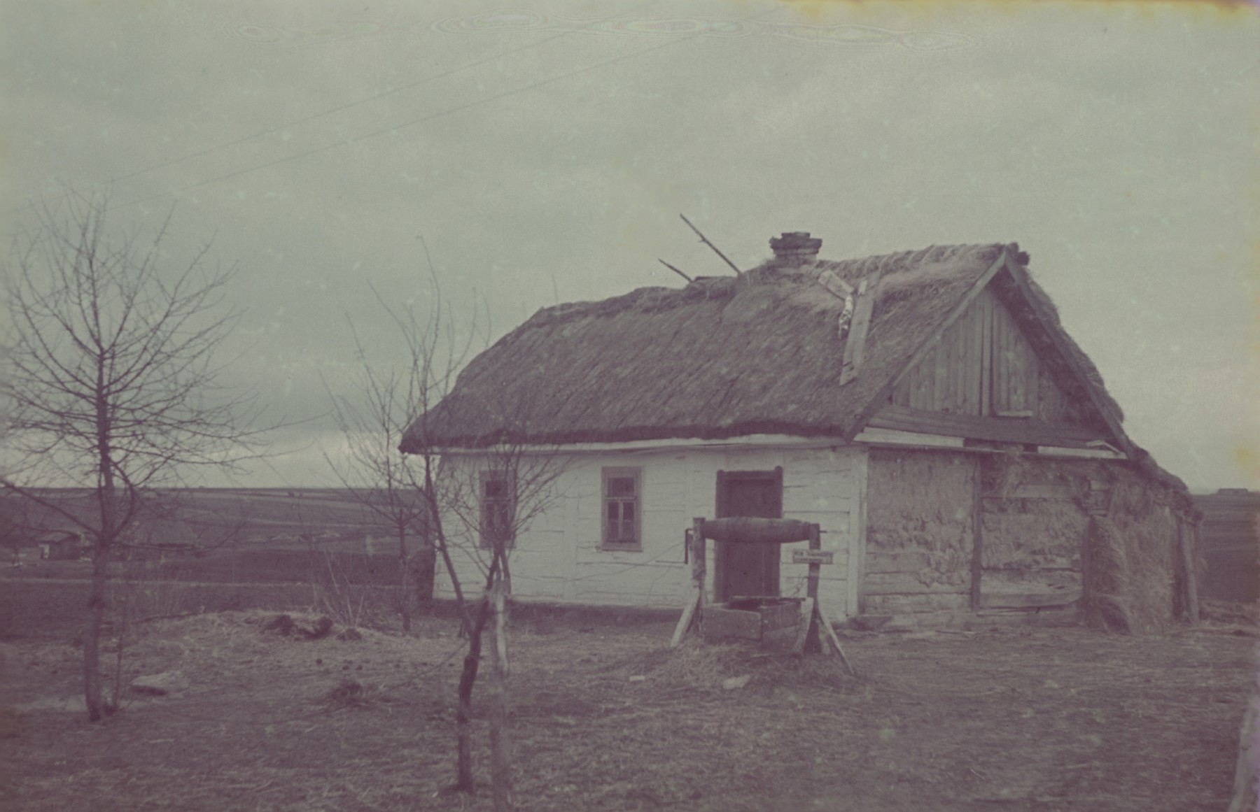 A view of a house with a thatched roof in or near Lodz.