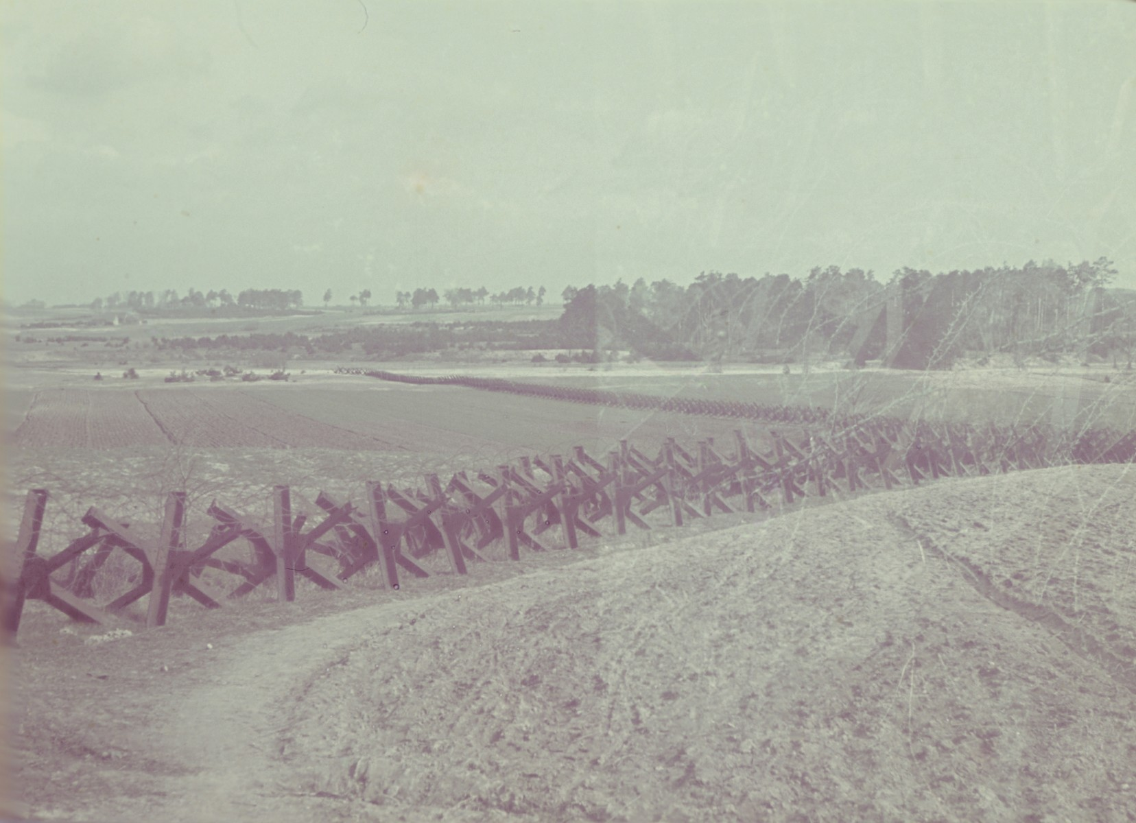 View of a fenced in field near Lublin from the Genewein collection.
