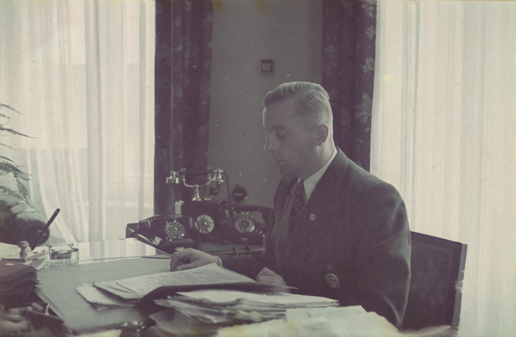 Hans Biebow, German head of the Lodz ghetto administration, at his desk.