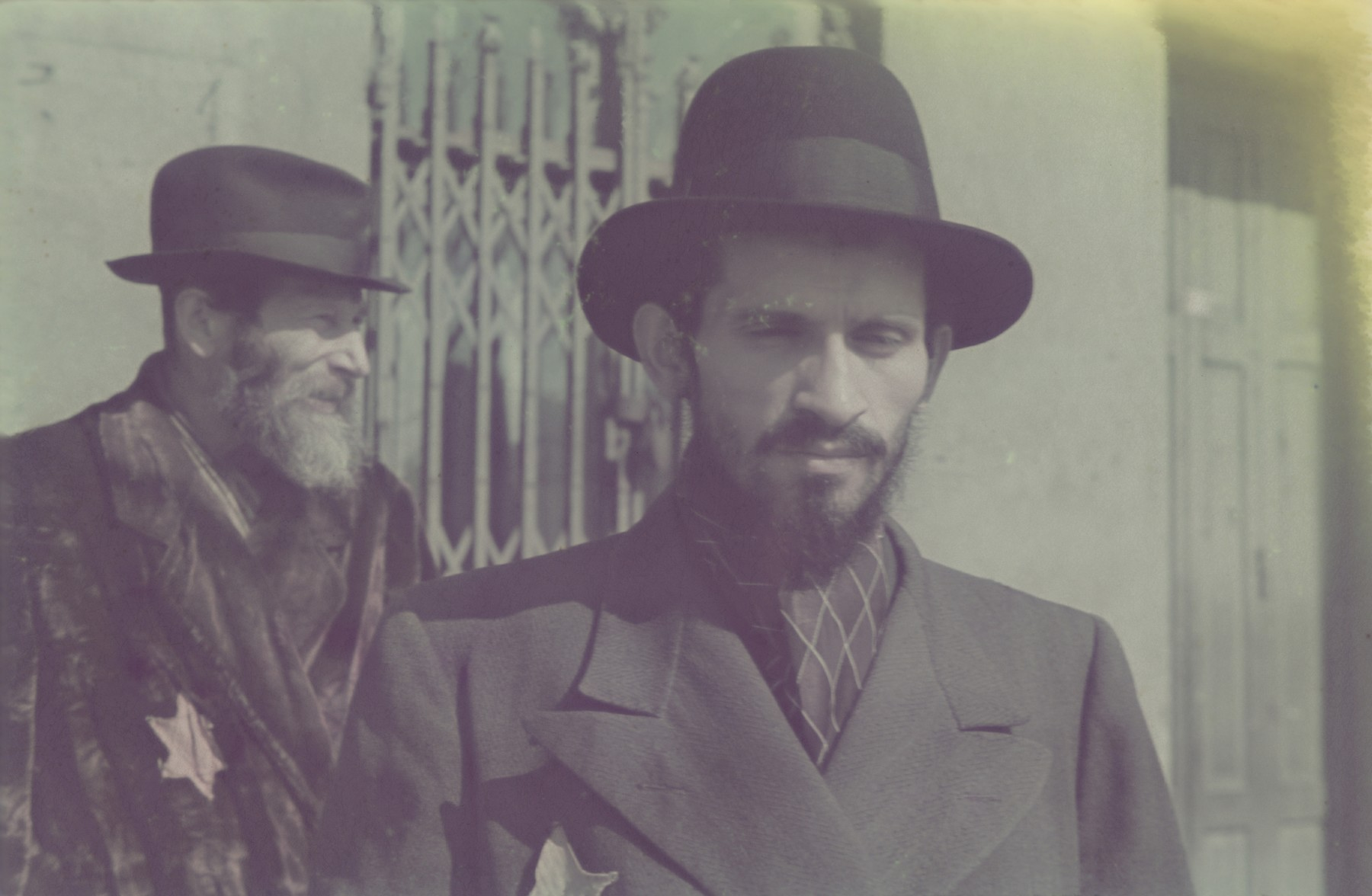 Close-up portrait of two bearded Jewish men in the Lodz ghetto.