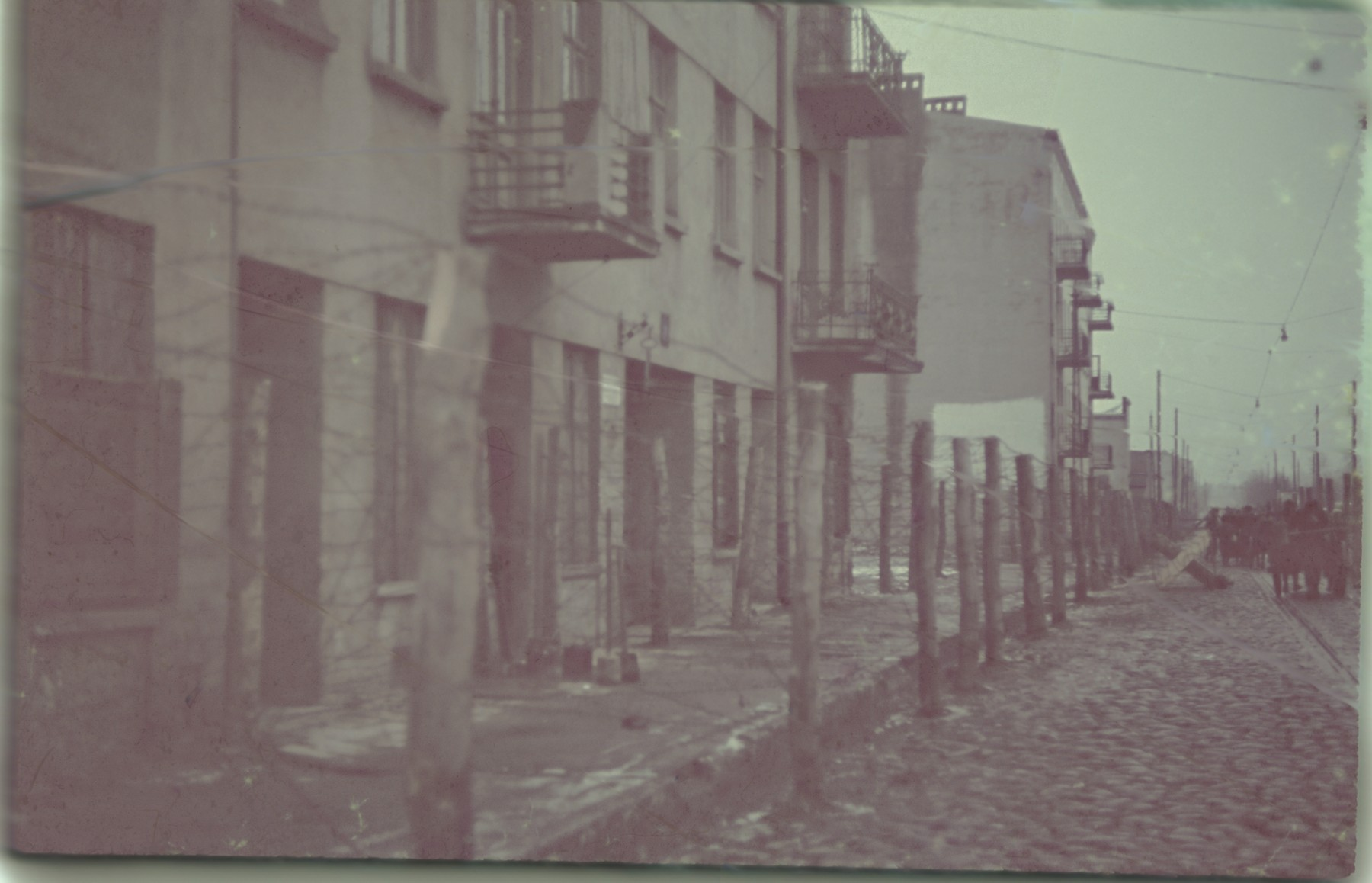 """View of the """"Gypsy camp"""" in Lodz.  The original German caption reads, """"Zigeunerlager"""" (""""Gypsy camp""""), #137."""