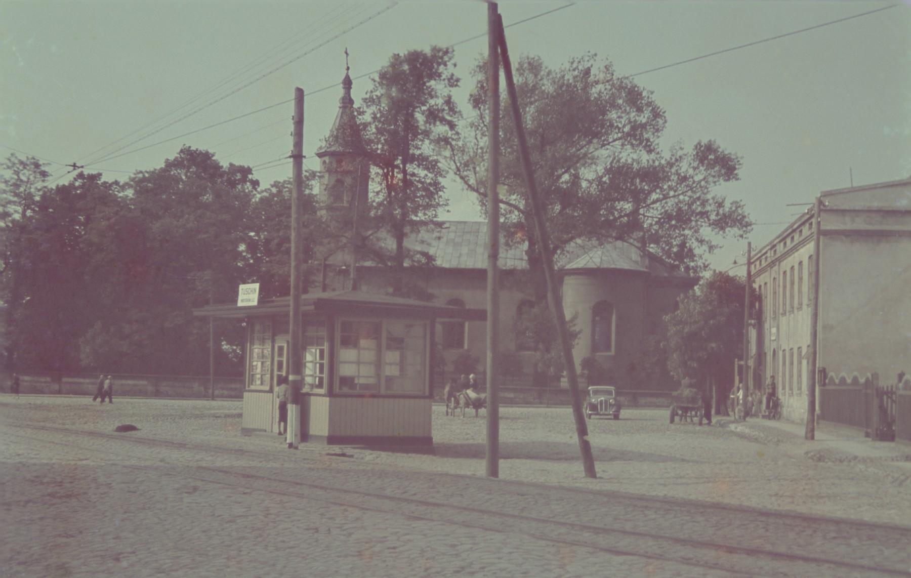 "A street scene in Tuszyn.  Original German caption: ""Tuschyn"", #111."