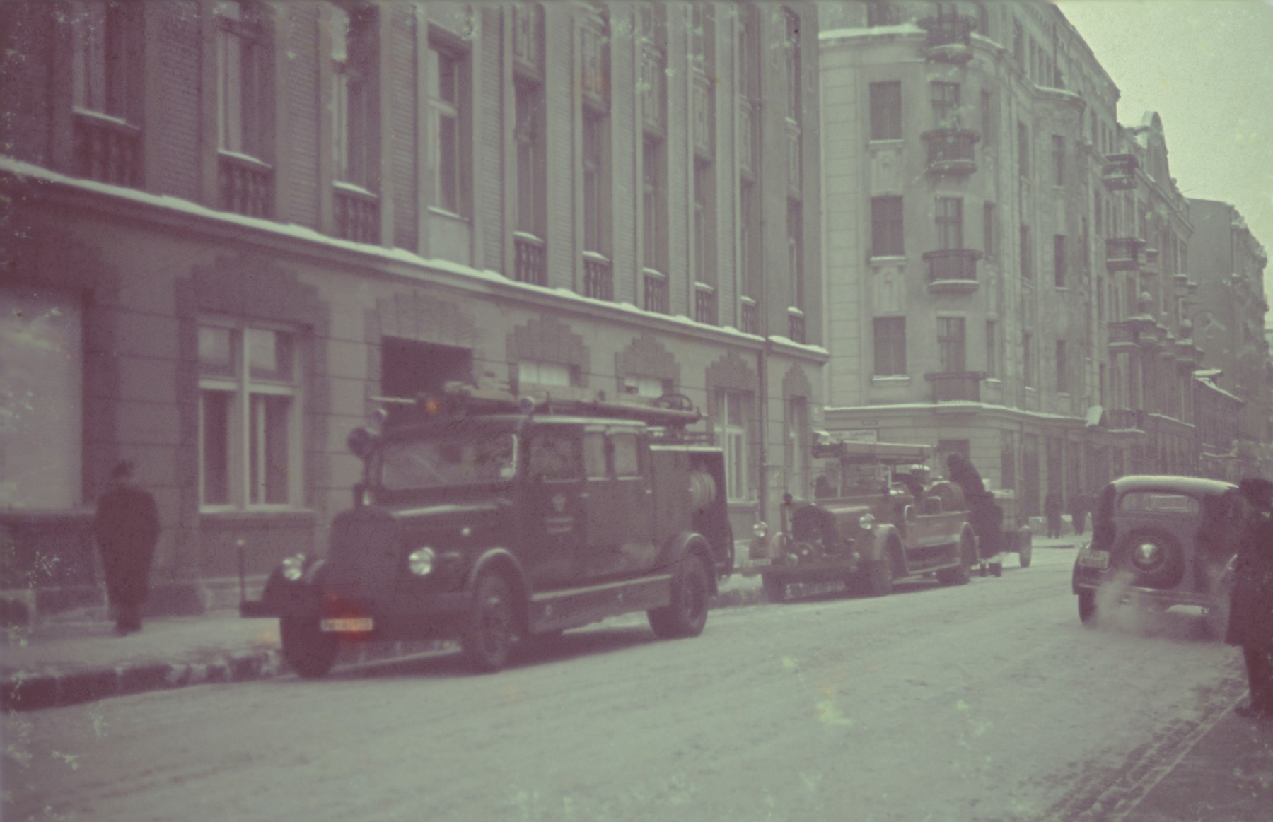 "Fire engines on a street of the Lodz ghetto.  Original German caption: ""?? in der Gettoverwaltung"", Winter 1941/1942"", #"