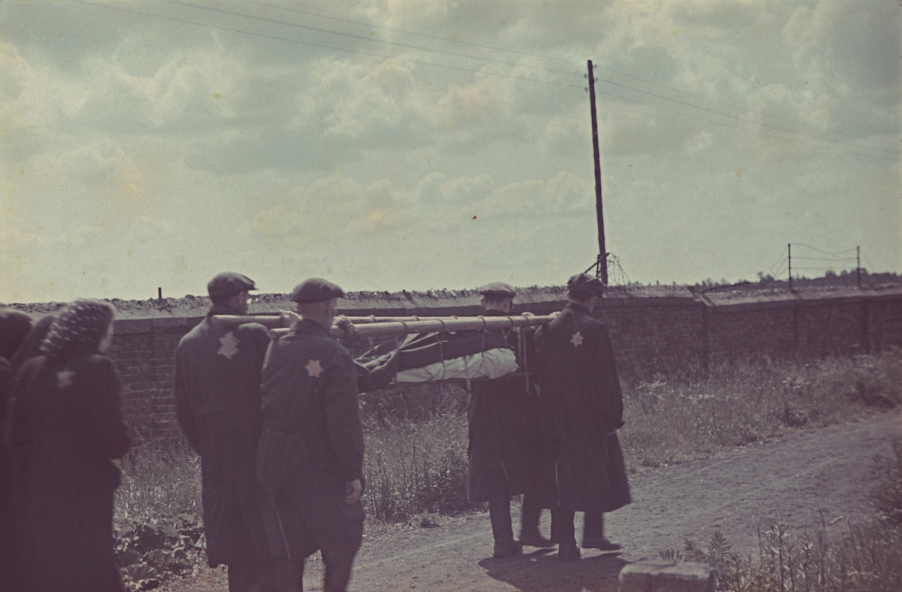 Pall bearers carry a stretcher with a corpse on their shoulders to the Jewish cemetery in Lodz.