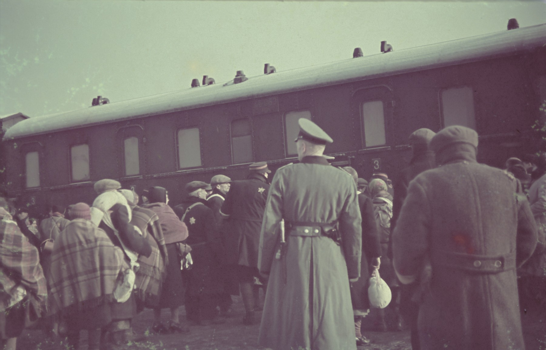 "Deportation of Jews from the Lodz ghetto to the Chelmno death camp.  Original German caption: ""Judenausseidlung"" (Jewish resettlement), April 1942, #135."