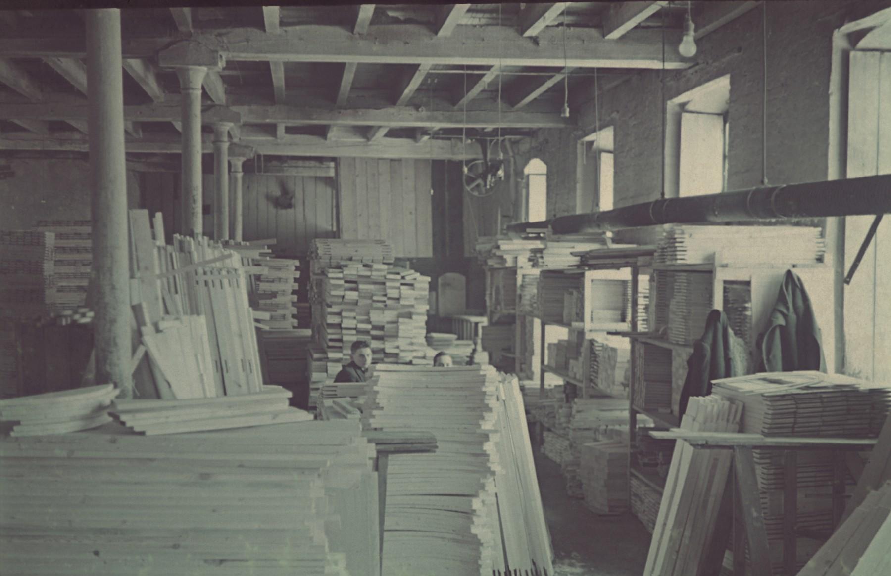 "Lumber stored in the furniture factory in the Lodz ghetto.  Original German caption: ""Moebelfabrik"" (furniture factory), #175, 221."