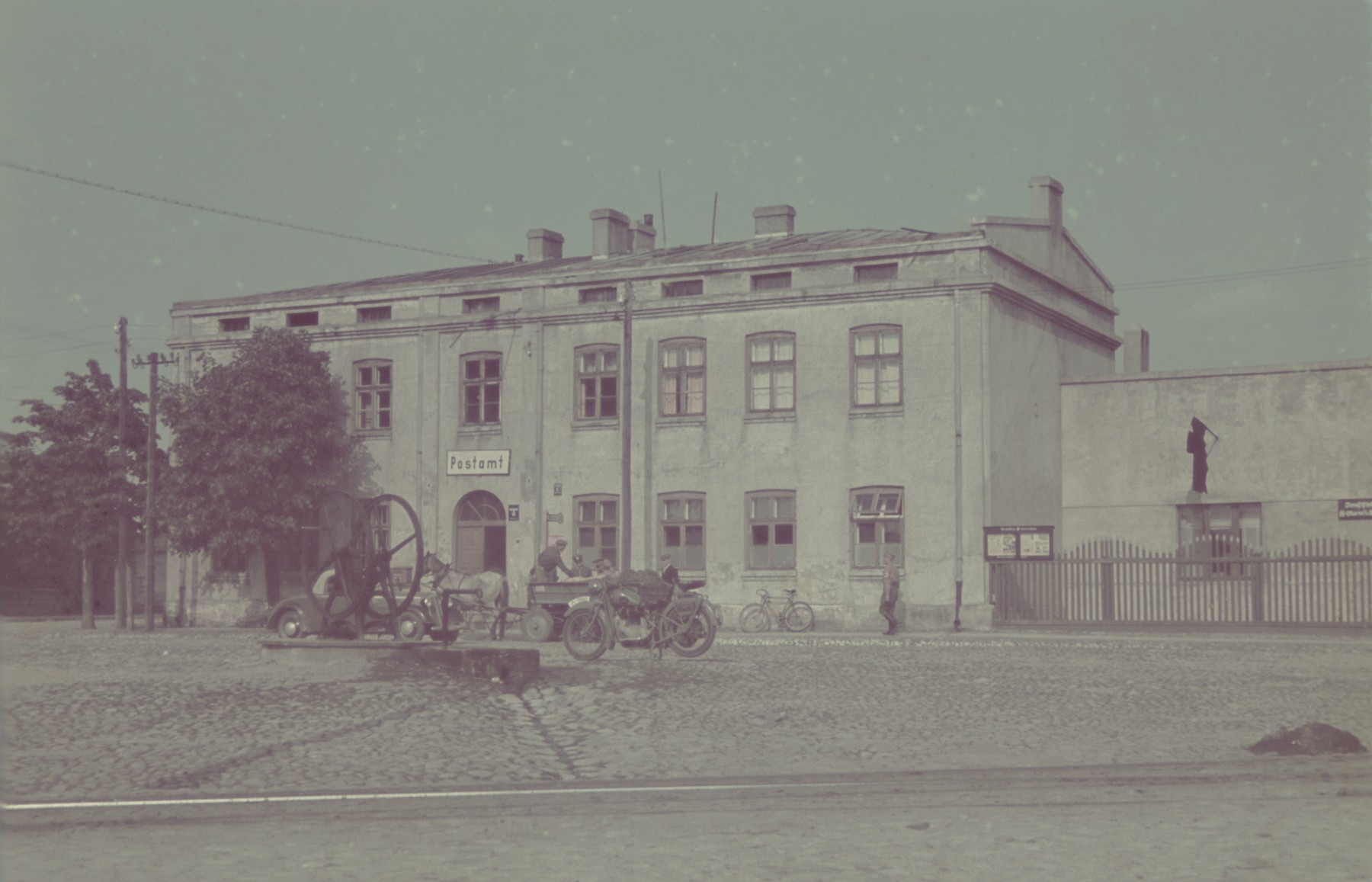 "Exterior view of the post office in Tuszyn.  Original German caption: ""Tuschyn"".  #112."