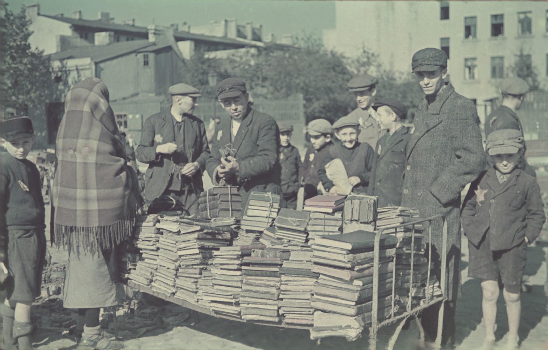 "Booksellers in the Lodz ghetto.  Original German caption: ""Strassenbild"" (street scene), #186."