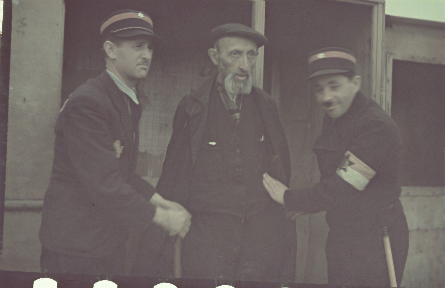 Jewish policemen arrest an elderly Jew in the Lodz ghetto in what appears to be a staged photograph.