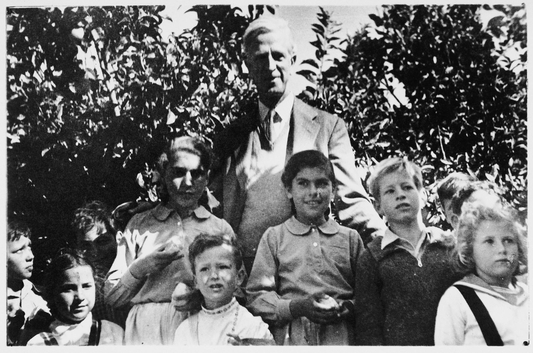 U.S. Ambassador to Israel, James G. McDonald, poses with a group of Israeli children.