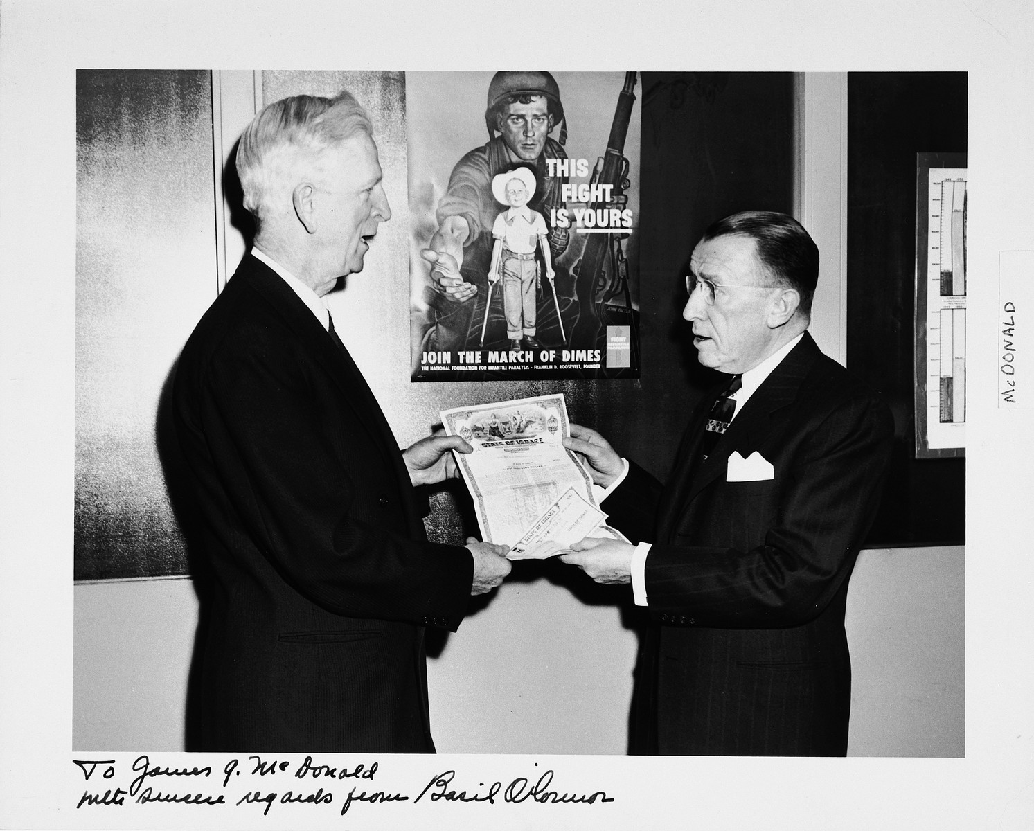 James G. McDonald (left), Chairman of the Advisory Council, Development Corporation for Israel, accepts a check for a State of Israel bond.  To the right is Basil O'Connor, Roosevelt's law partner.
