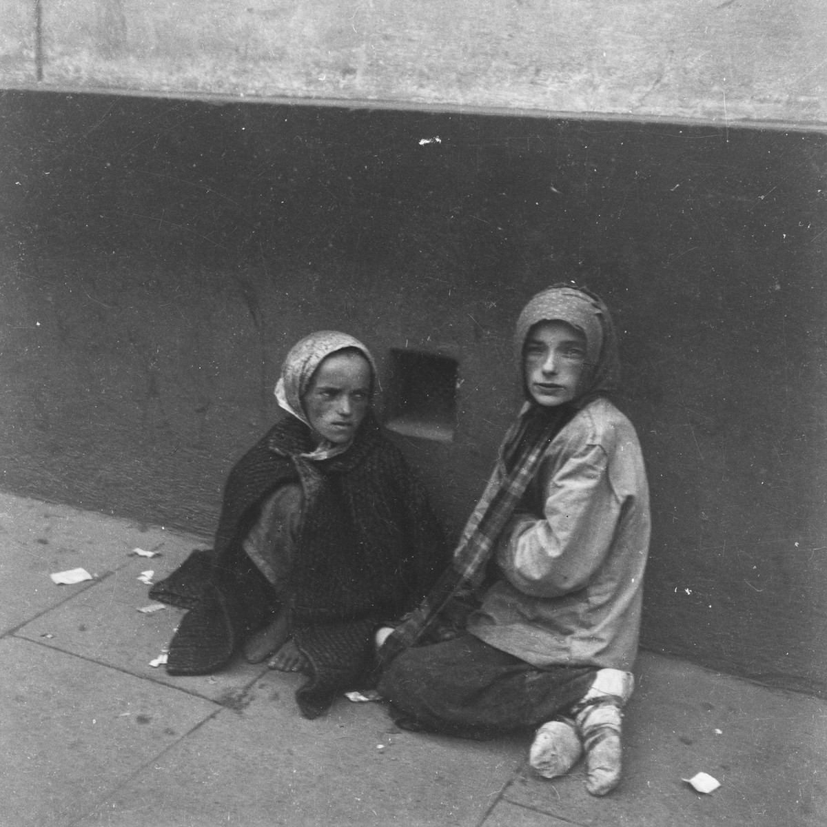 "Two children beg for food on the streets of the Warsaw ghetto.    Joest's original caption reads: ""It was the 19th of September and a cold day when I took pictures of these two girls in Krochmalna Street.  One could see that they were sick and had no more strength to live."""
