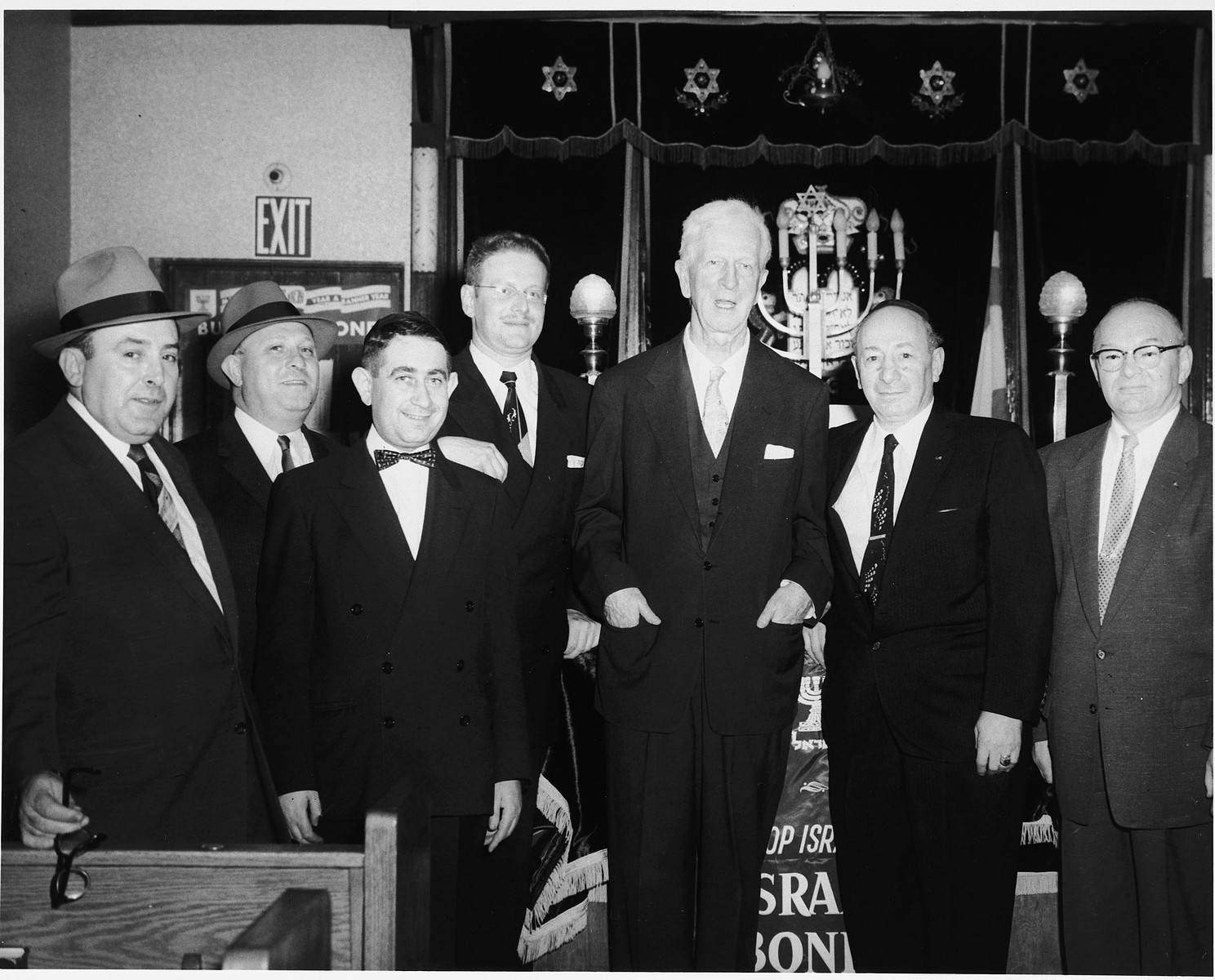 U.S. Ambassador to Israel James G. McDonald (center), poses with a group of men at a State of Israel bonds drive at a synagogue in the U.S.