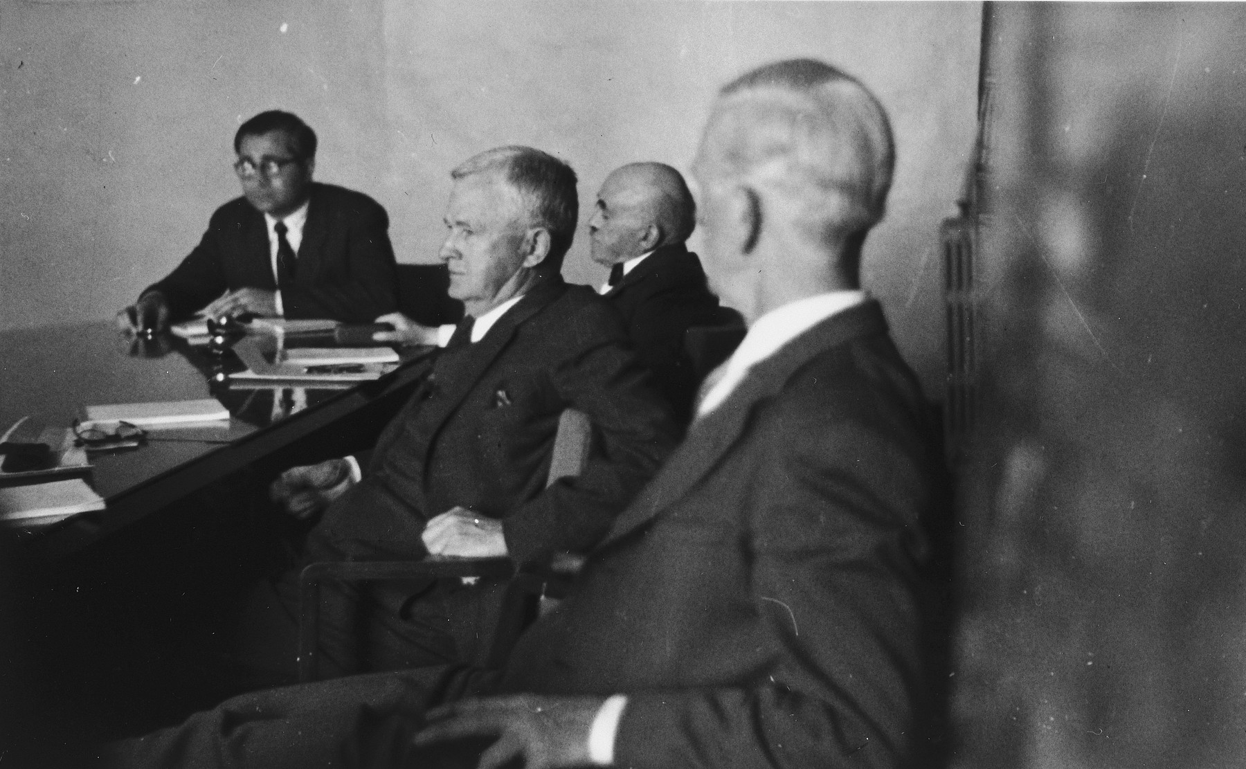 Members of the Anglo-American Committee of Inquiry on Palestine attend a hearing at the YMCA building in Jerusalem.  Among those pictured are James G. McDonald (foreground, right) and Judge Joseph Hutcheson, the American chairman (center, next to McDonald).