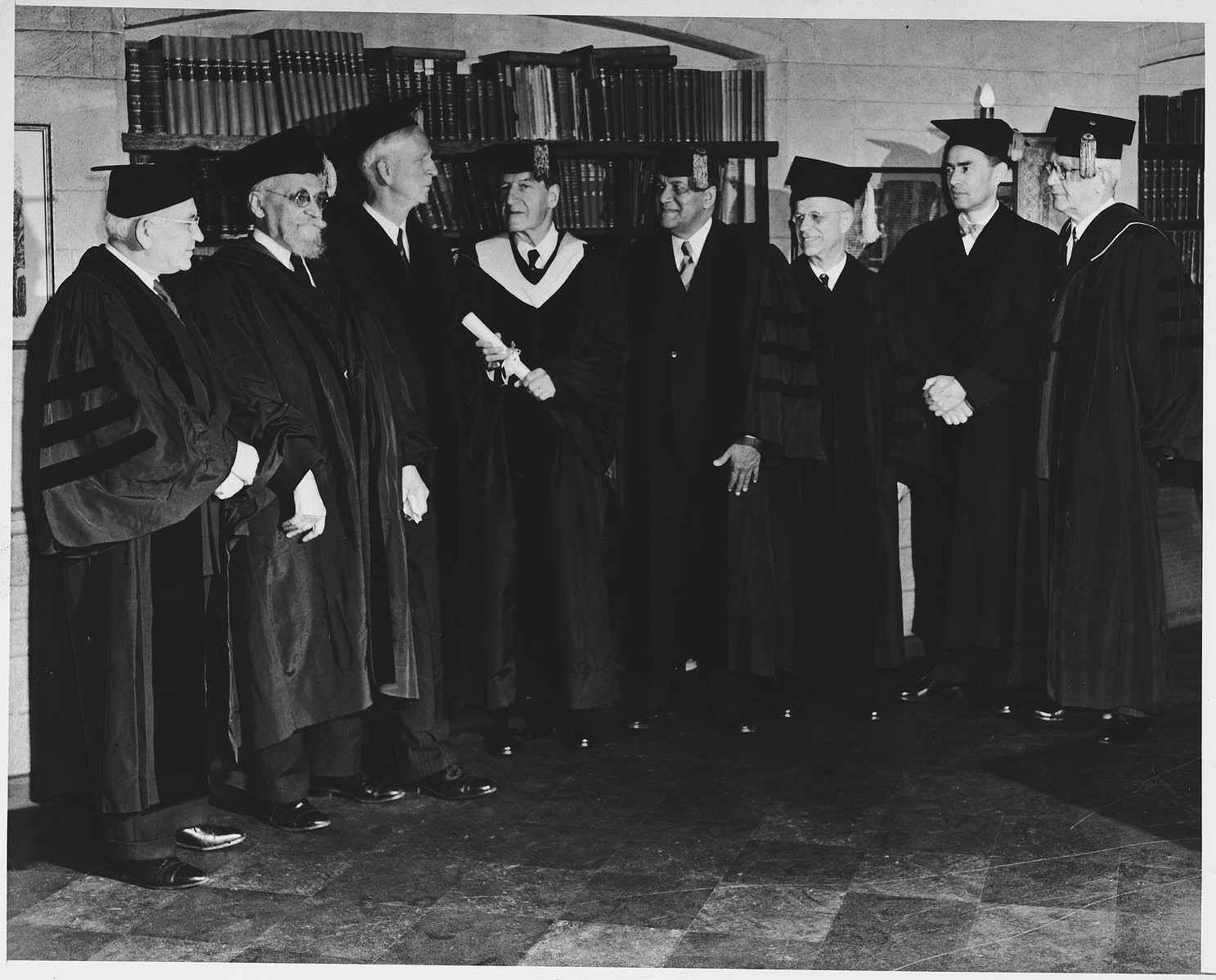 Group portrait of faculty members and recipients of honorary degrees at the 1947 commencement of the Jewish Institute of Religion in New York.  Among the honorees is James G. McDonald.  Pictured from left to right are Rabbi Solomon Goldman (Anshe Emet Synagogue, Chicago), Dr. Chaim Tchernowitz (professor of Talmud), James G. McDonald (member of the Anglo-American Committee of Inquiry on Palestine), Dr. Stephen S. Wise, Dr. Channing Tobias (religious and social leader), Dr. Julian Morgenstern (president of Hebrew Union College, Dr. Nelson Glueck (president-elect of the Hebrew Union College), and Dr. Henry Slonimsky (dean of the faculty).