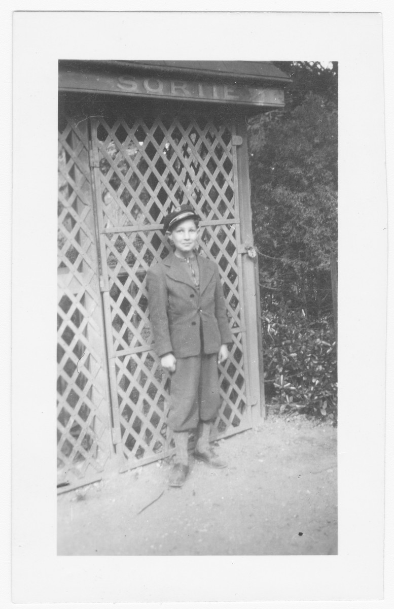 Steven Simon wearing a Catholic boarding school cap near the entrance to his school which he attended while in hiding in Lyon in 1943.