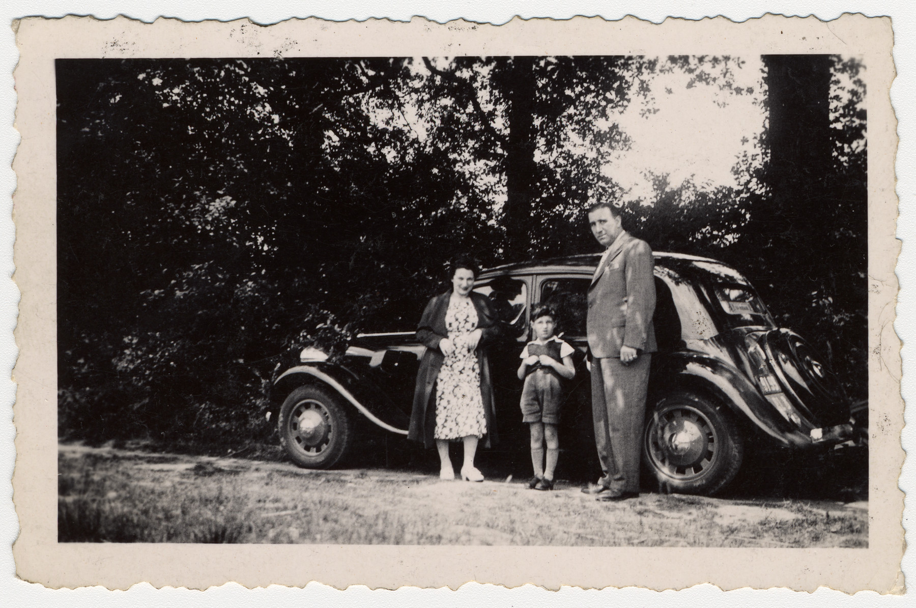 Steven Simon in middle with his parents, Irma Rachel Simon and Arthur Simon, next to their family car on vacation in 1939 prior to WW II.  The French army requisitioned the automobile as soon as the war broke out.