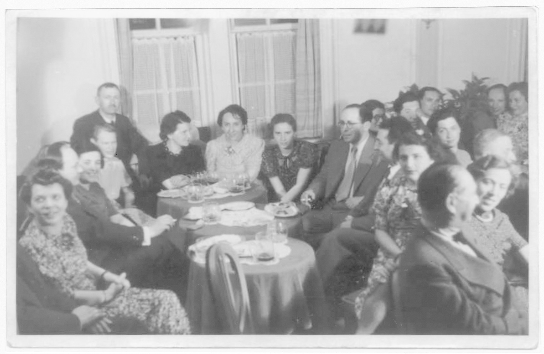 Passengers on board the St. Louis dine together.  Among those pictured are (back row) Mr. and Mrs. Karliner, Vera Spitz, Erna Ring, and Ursula Spitz.