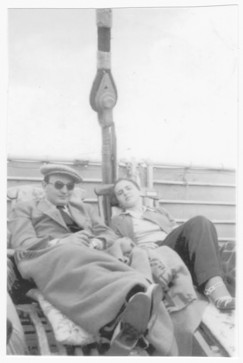 Passengers relax on deck aboard the St. Louis.  Pictured are Dr. Weisler and Ursula Spitz (later Miller).