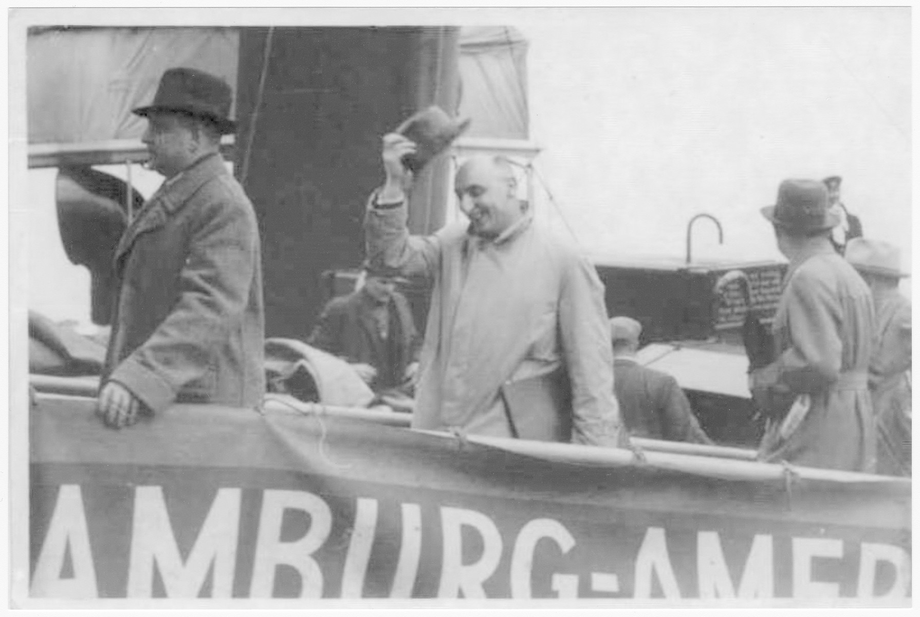 George Spitz (center) boards a ship for Cuba to set up a home for his family, two weeks prior to the departure of the St. Louis.