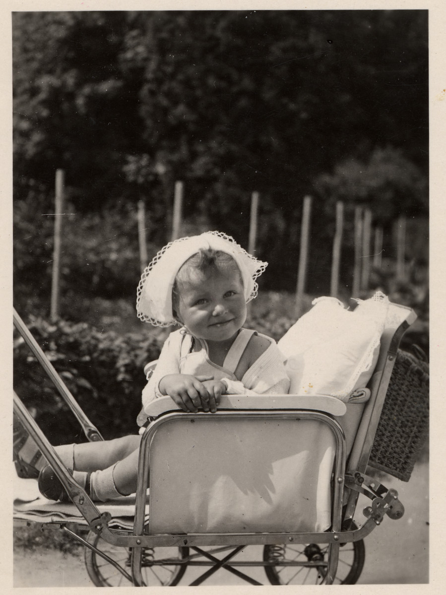 Close-up of a Jewish toddler sitting in her baby stroller.  Pictured is the donor, Illa Kitz.