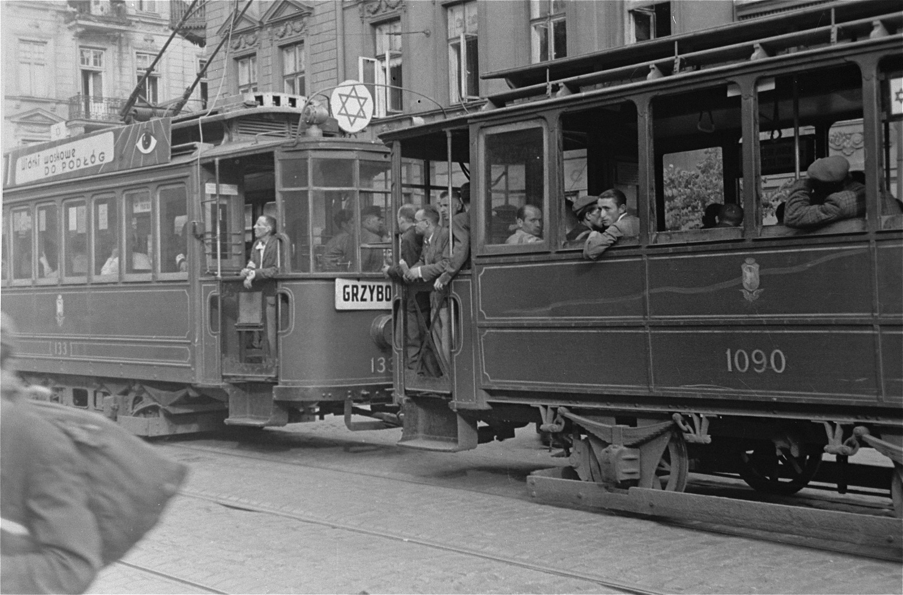 Jews ride in a streetcar marked with a Jewish star in the Warsaw ghetto.