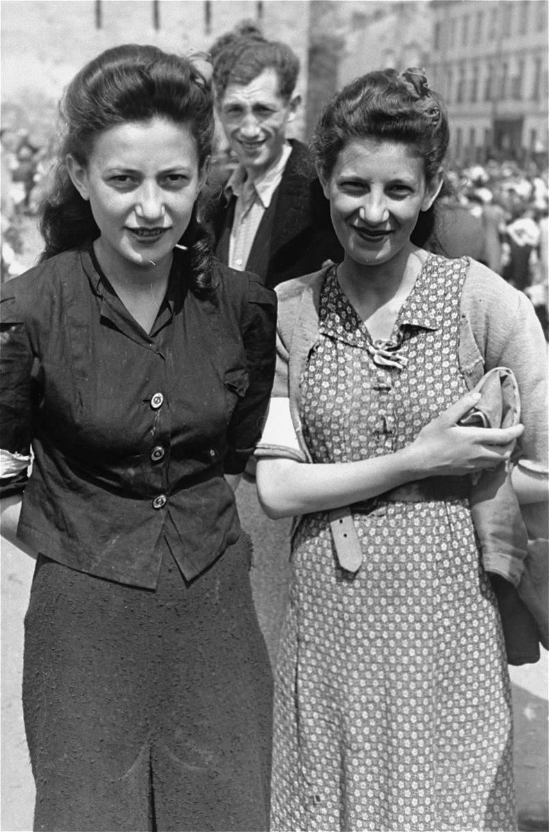 Two sisters at an outdoor market in the Warsaw ghetto.