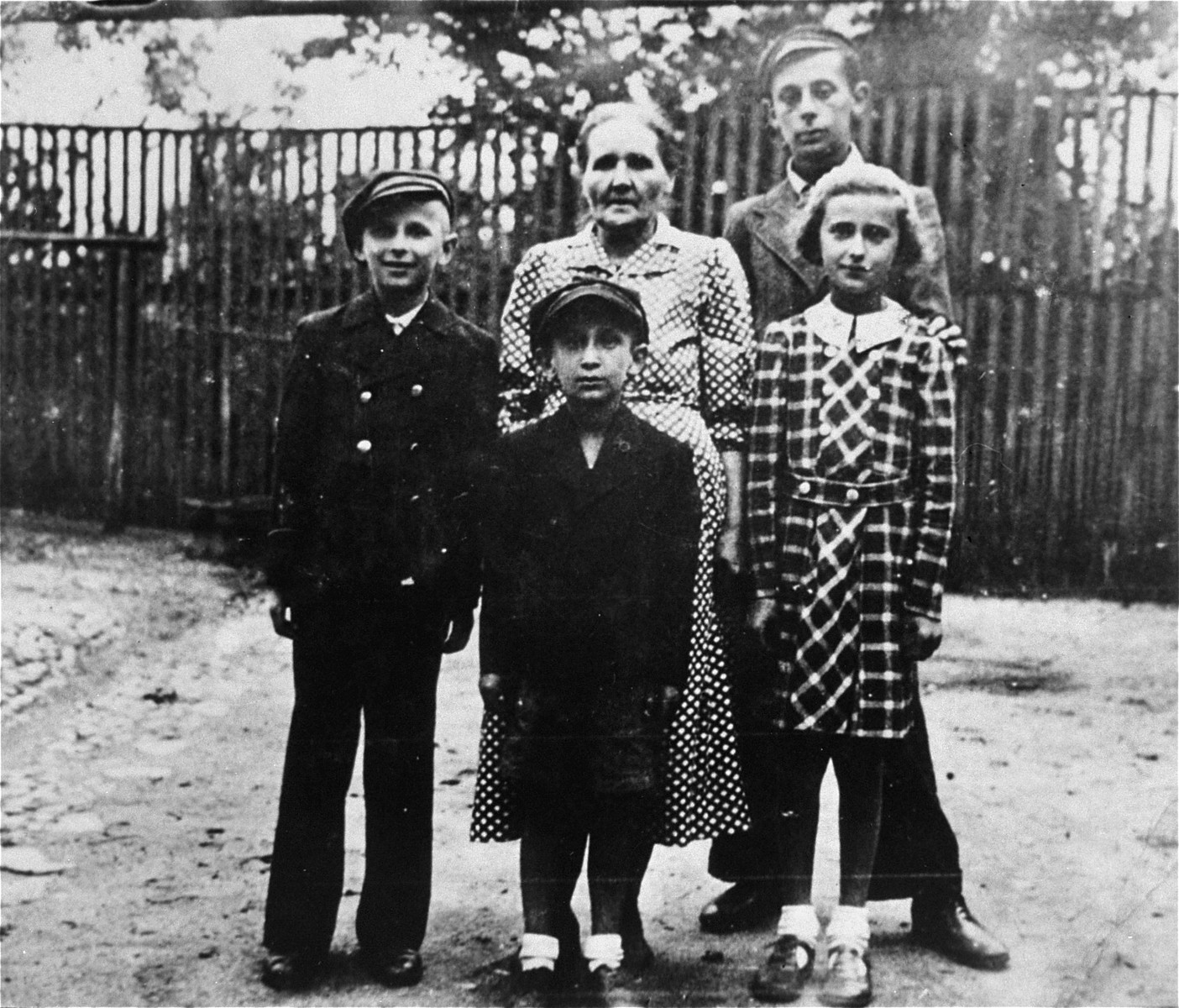 Pictured here is Cesia Carol Uncyk, her three brothers, and their Polish nanny.