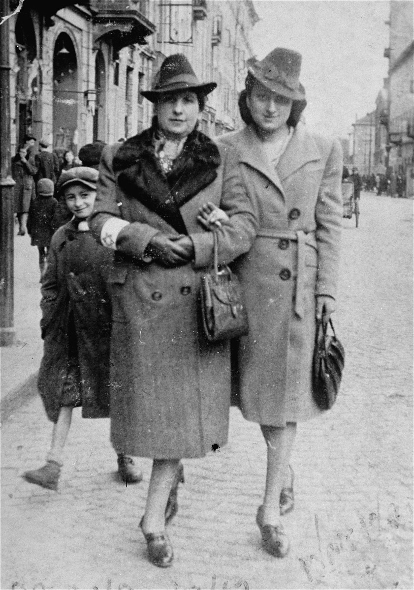Sylvia Kramarski Kolski with her mother on the streets of the Warsaw ghetto.  Mrs. Kolski kept all of her pre-war and wartime photos in a cloth pouch around her neck after her mother appeared to her in a dream telling her to do so. She was thus able to preserve them throughout the two year period she was in hiding.