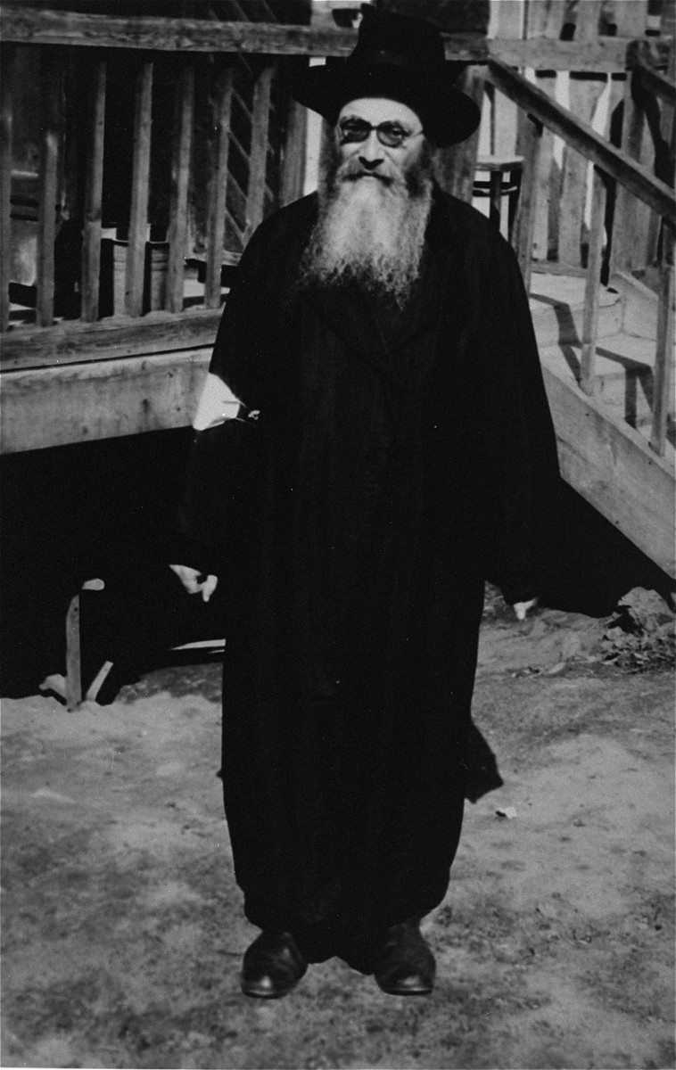 Portrait of an elderly Jewish man wearing an armband in an unidentified ghetto.