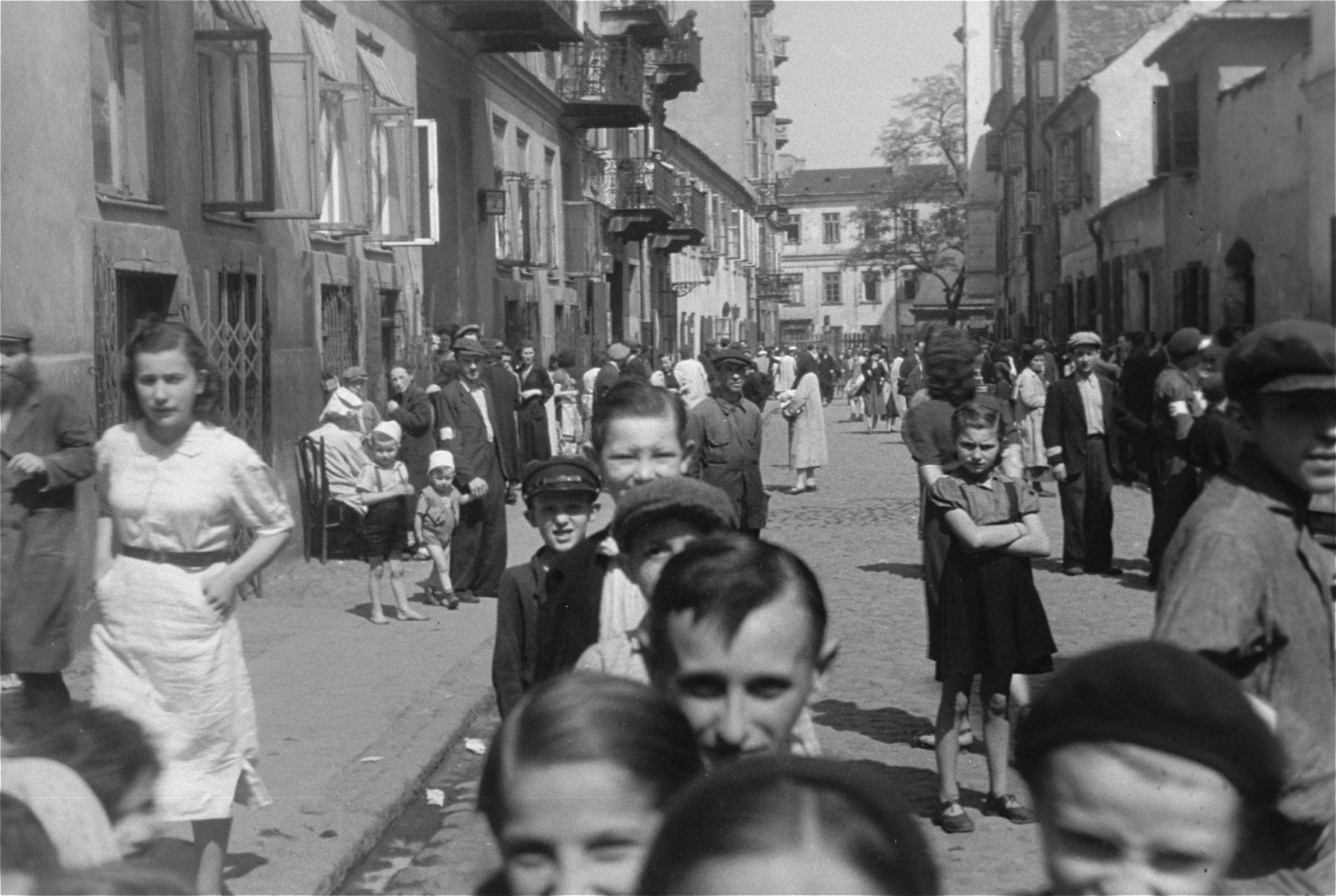 Jews mill around on a side street in the Warsaw ghetto.