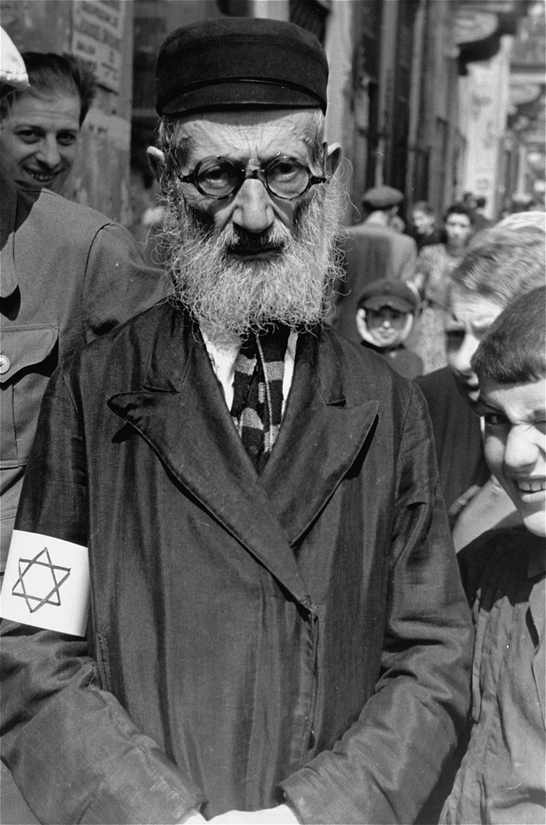Portrait of an elderly, bearded Jew on the street in the Warsaw ghetto.