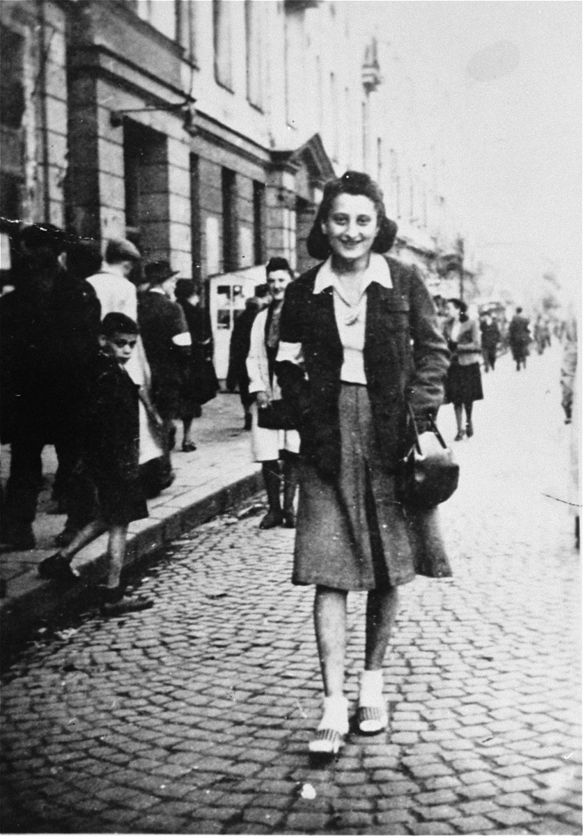 Sylvia Kramarski Kolski, on the streets of the Warsaw ghetto.   She was 21 years old at the time. Mrs. Kolski kept all of her pre-war and wartime photos in a cloth pouch around her neck after her mother appeared to her in a dream telling her to do so. She was thus able to preserve them throughout the two year period she was in hiding.