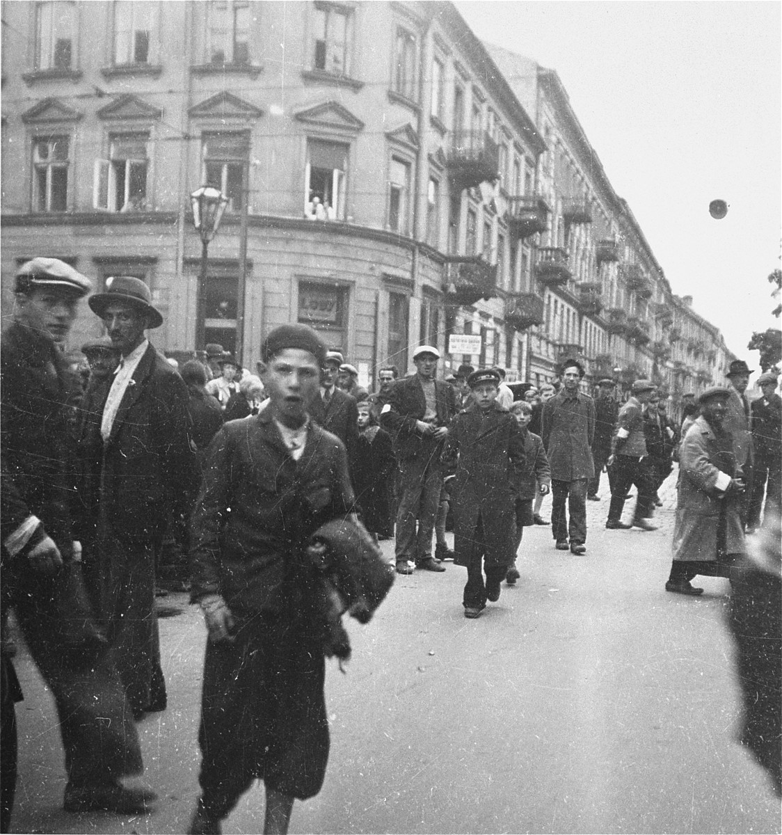 "Jews on the street at a major intersection in the Warsaw ghetto.    Joest's caption reads: ""What should I say about this?  People upon people on the street.  I could not imagine at that time where they should all go."""
