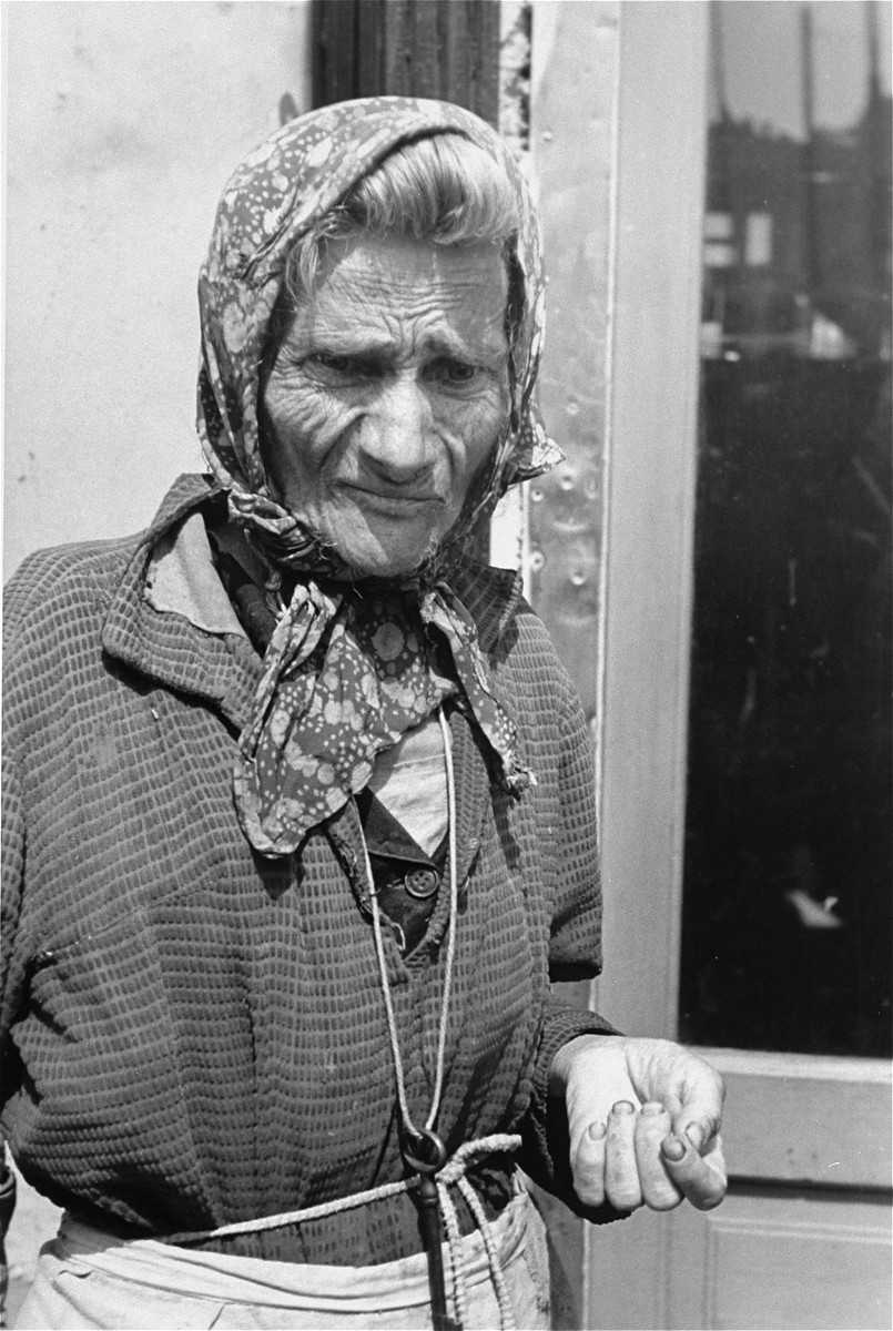 Portrait of an elderly Jewish woman wearing a head scarf in the Warsaw ghetto.