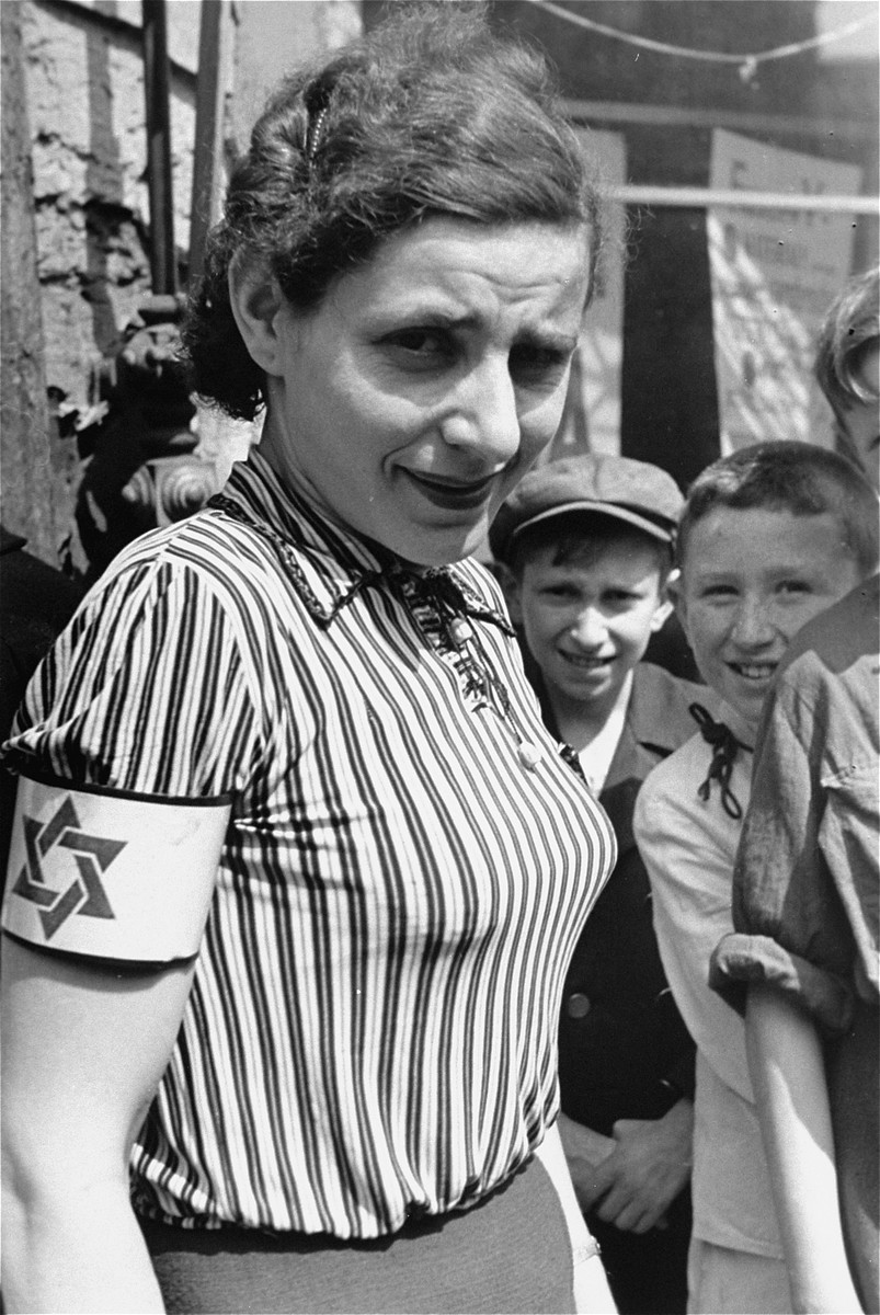 Portrait of a woman wearing a striped blouse and an armband in the Warsaw ghetto.