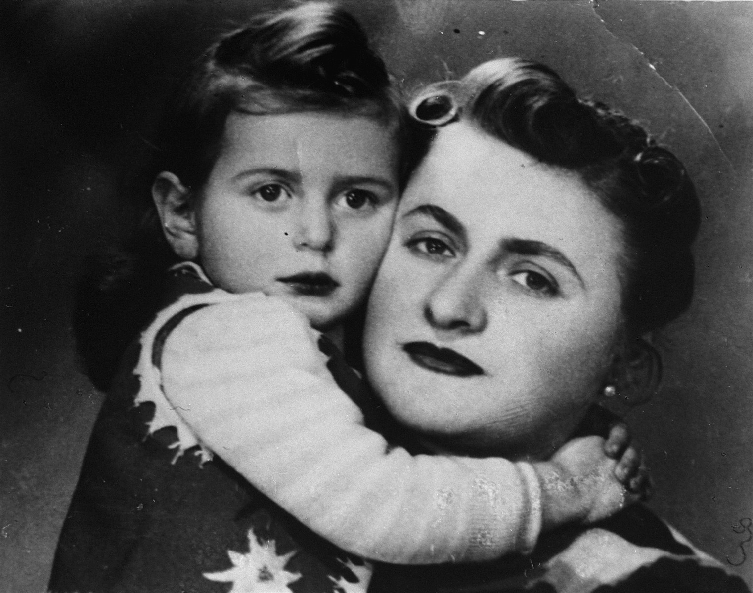 Portrait of Thea Borzuk and her mother taken in the Warsaw ghetto on her second birthday.