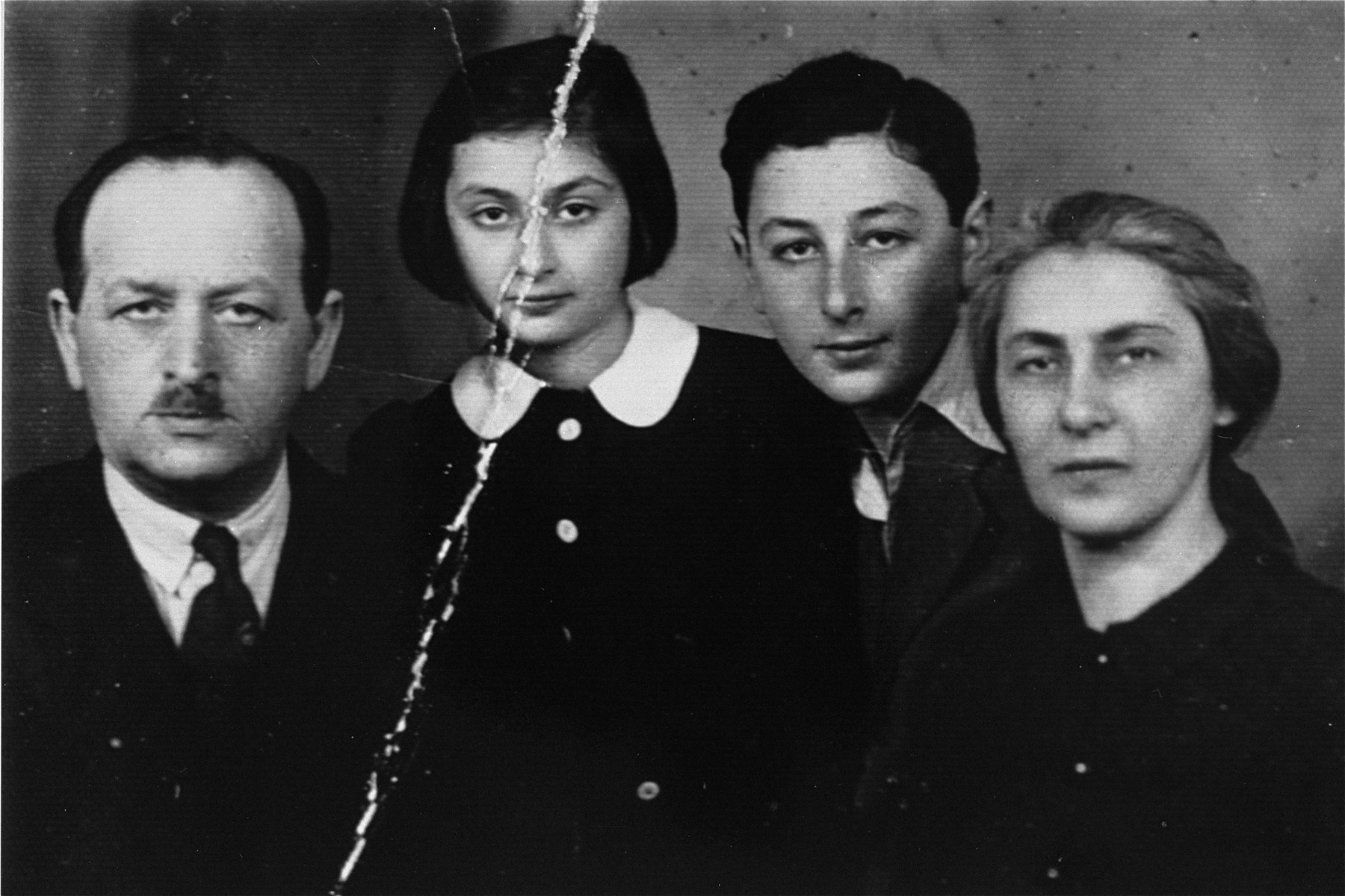Passport photo of the Rozenman family, prepared in the Warsaw ghetto for a possiblity of an escape.    Pictured from right to left: Regina Renia, the donor's mother; Ryszard, donor's brother; Bianka, the donor and Pawel Rozenman, donor's father.  Bianka is the only survivor.