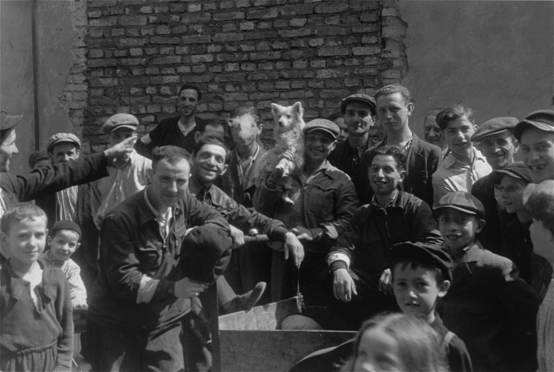 Jews are gathered on a street in the Warsaw ghetto.
