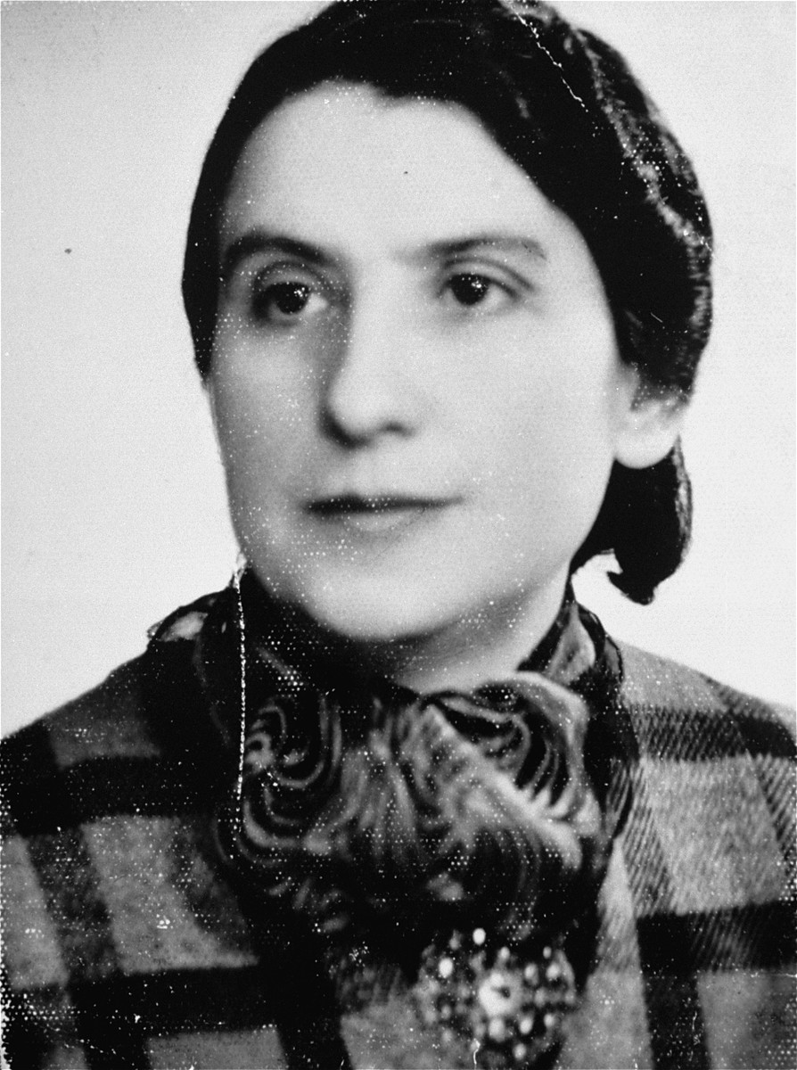 A portrait of Frymet Kramarska, the donor's mother. This portrait was taken for an identification card while Mrs. Kramarska was in the ghetto. She was deported to Treblinka in 1942.