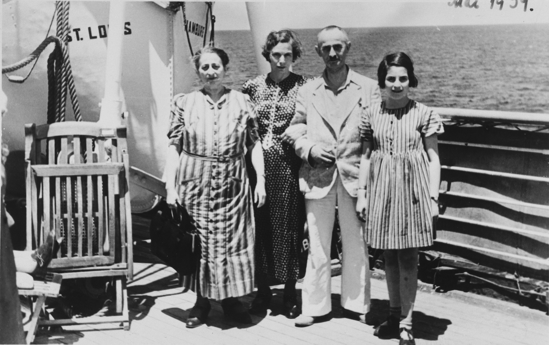 The Arndt family stands on deck of the St. Louis.  Pictured from left to right are Paula Kahnemann, Hertha Arndt, Arthur Arndt, and Lieselotte Arndt.