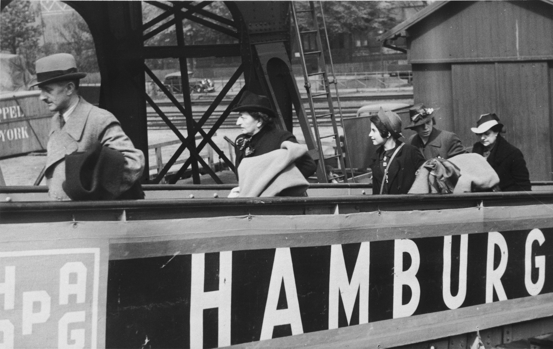 The Arndt family boards the St. Louis in Hamburg harbor prior to its departure.  Pictured from left to right are Arthur Arndt, Paula Kahnemann, Lieselotte Arndt and Hertha Arndt.