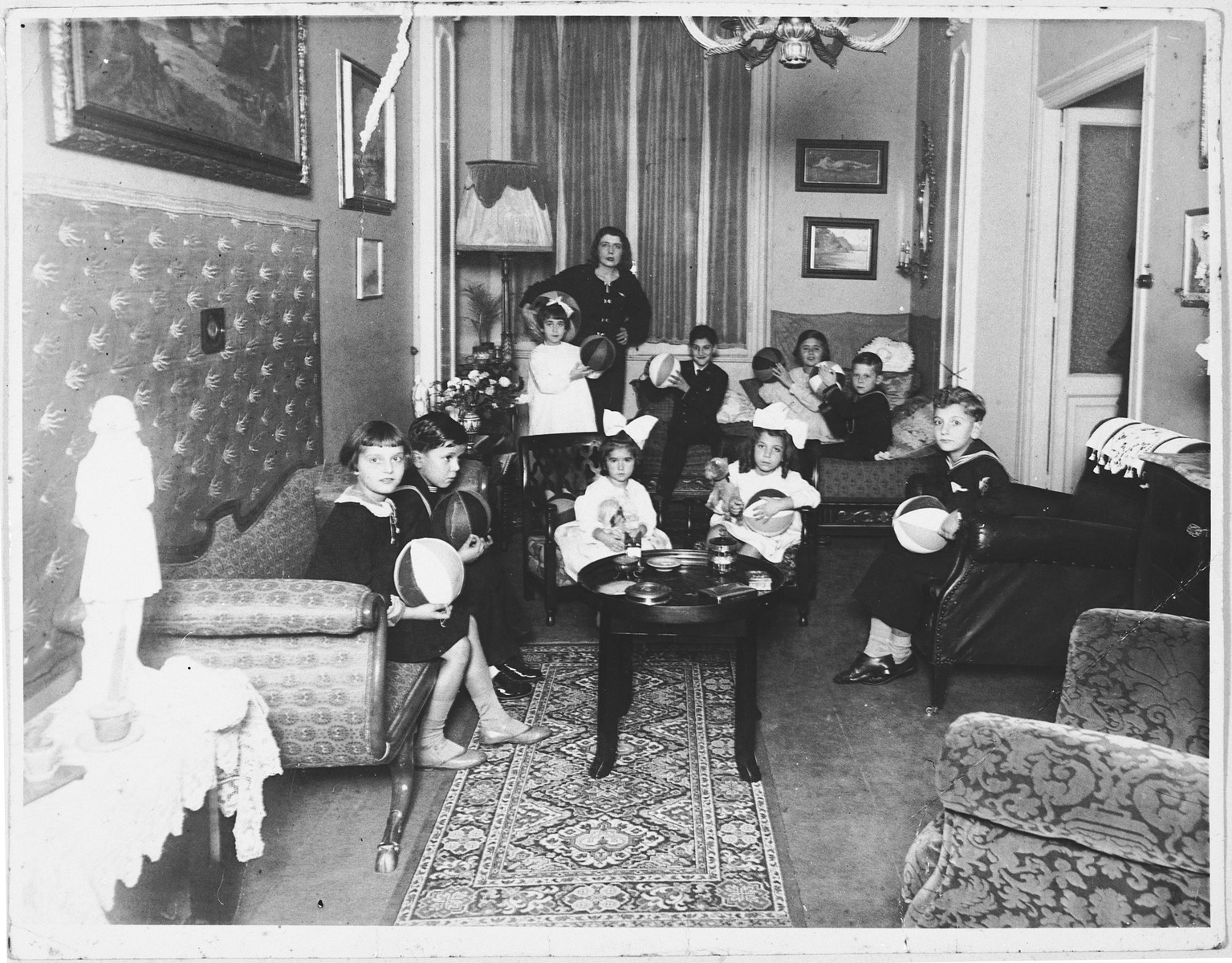 Jewish children attend a birthday party in an opulent apartment in Rome owned by a Hungarian Jewish woman.  Among those pictured are Serenella and Avishua Foa and their cousins, Anna and Andrea Bises.
